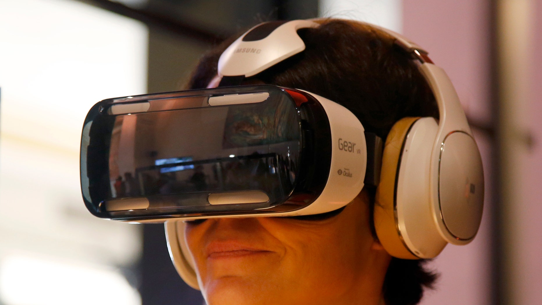 An attendee tries an Oculus-powered Samsung Gear VR headset during French telecom company Orange's annual innovations show in Paris Oct. 2, 2014.