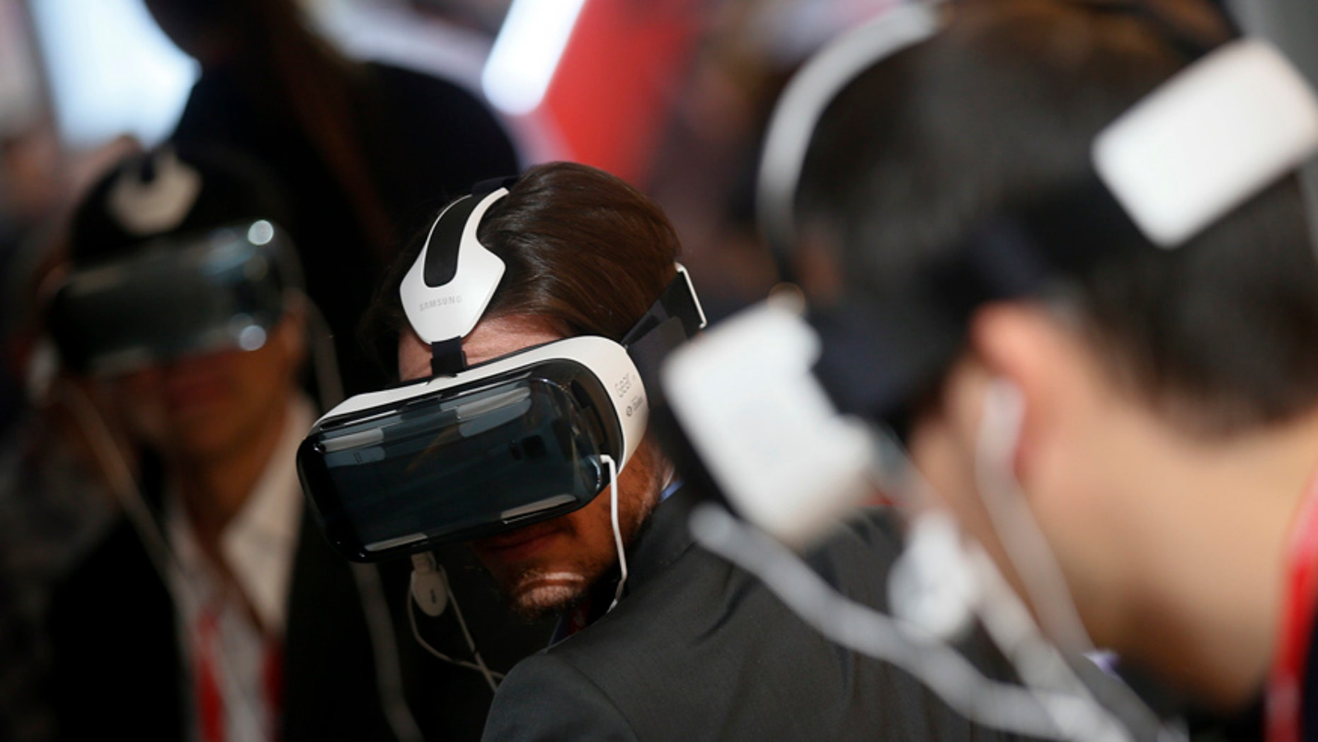 File photo. Visitors check Samsung's new virtual reality (VR) headset called the Gear VR Innovation Edition during the Mobile World Congress in Barcelona March 3, 2015.