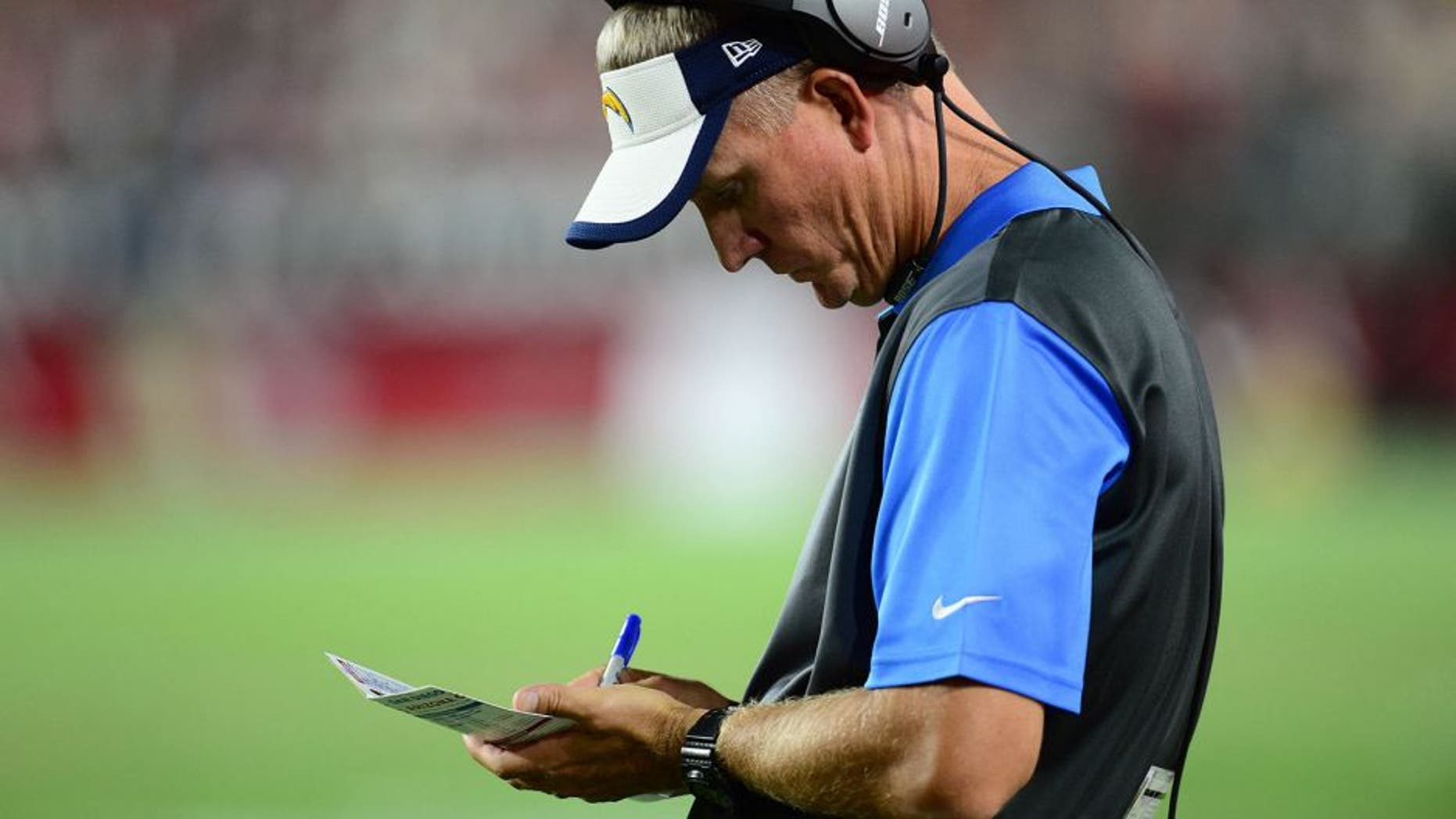 Aug 22, 2015; Glendale, AZ, USA; San Diego Chargers head coach Mike McCoy looks on against the Arizona Cardinals during the first half at University of Phoenix Stadium. The Chargers won 22-19. Mandatory Credit: Joe Camporeale-USA TODAY Sports