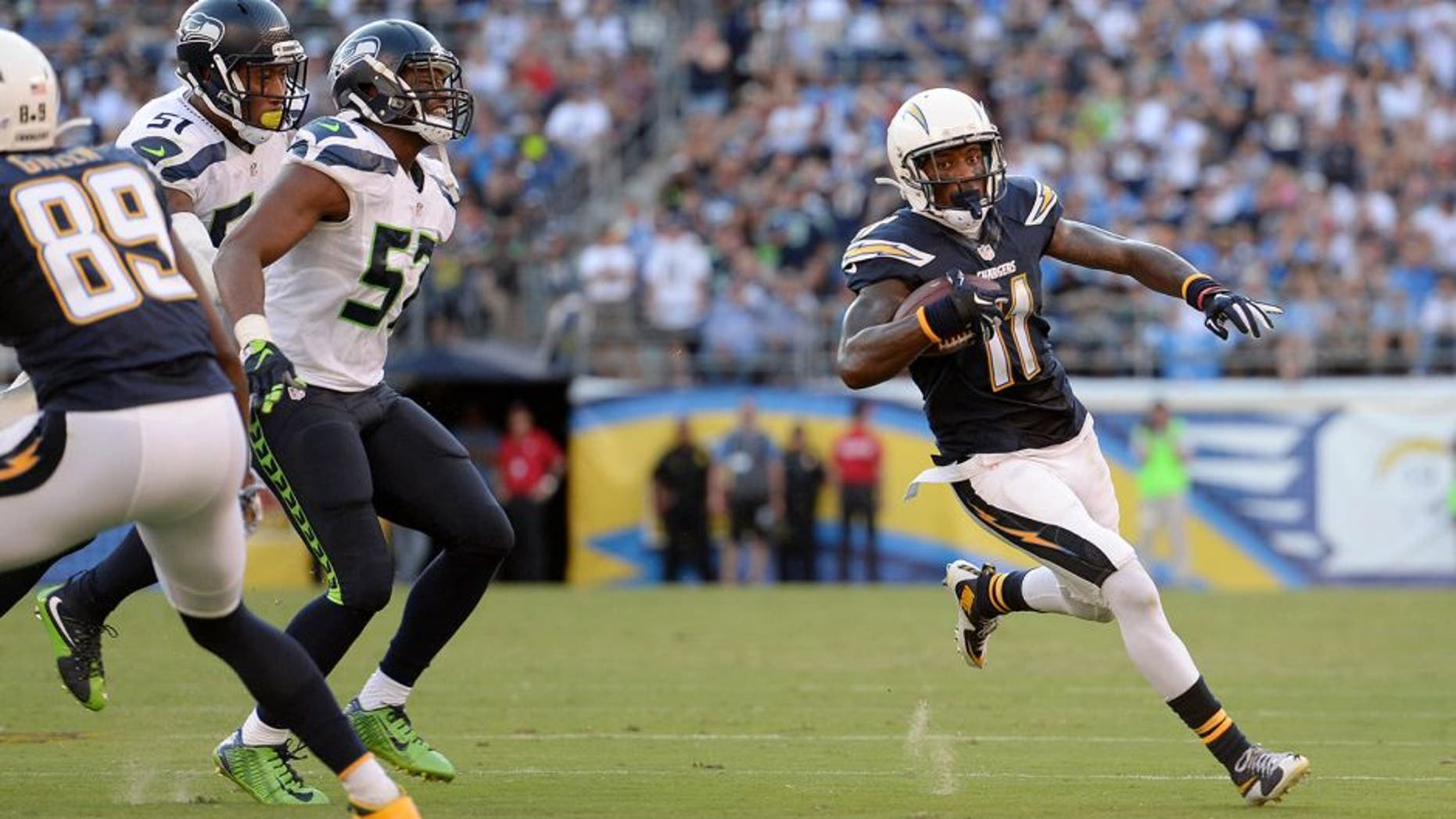 Aug 29, 2015; San Diego, CA, USA; San Diego Chargers wide receiver Steve Johnson (11) runs after making a catch during the second quarter against the Seattle Seahawks at Qualcomm Stadium. Mandatory Credit: Jake Roth-USA TODAY Sports