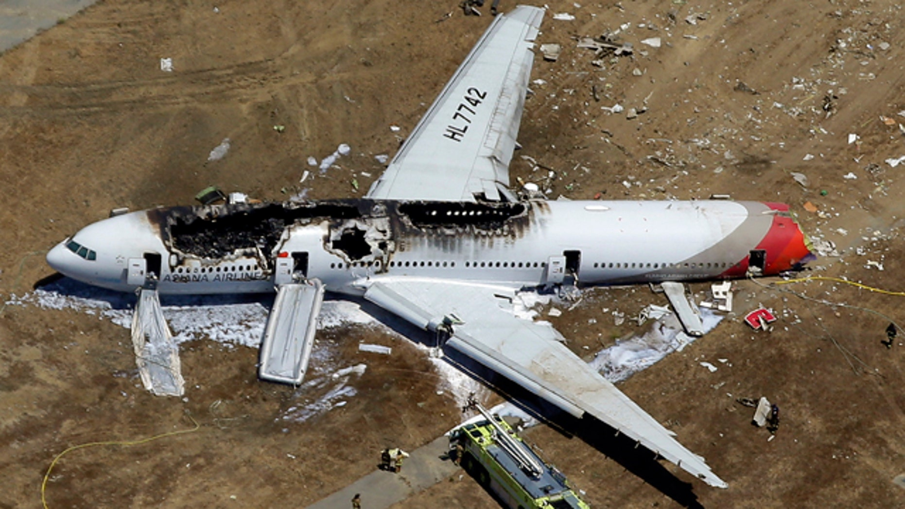 FILE - In this July 6, 2013 aerial file photo, the wreckage of Asiana