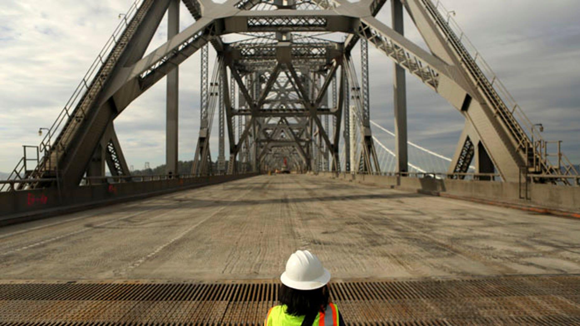 Nov. 12, 2013: A journalist looks over the original east span of the San Francisco Oakland Bay Bridge,