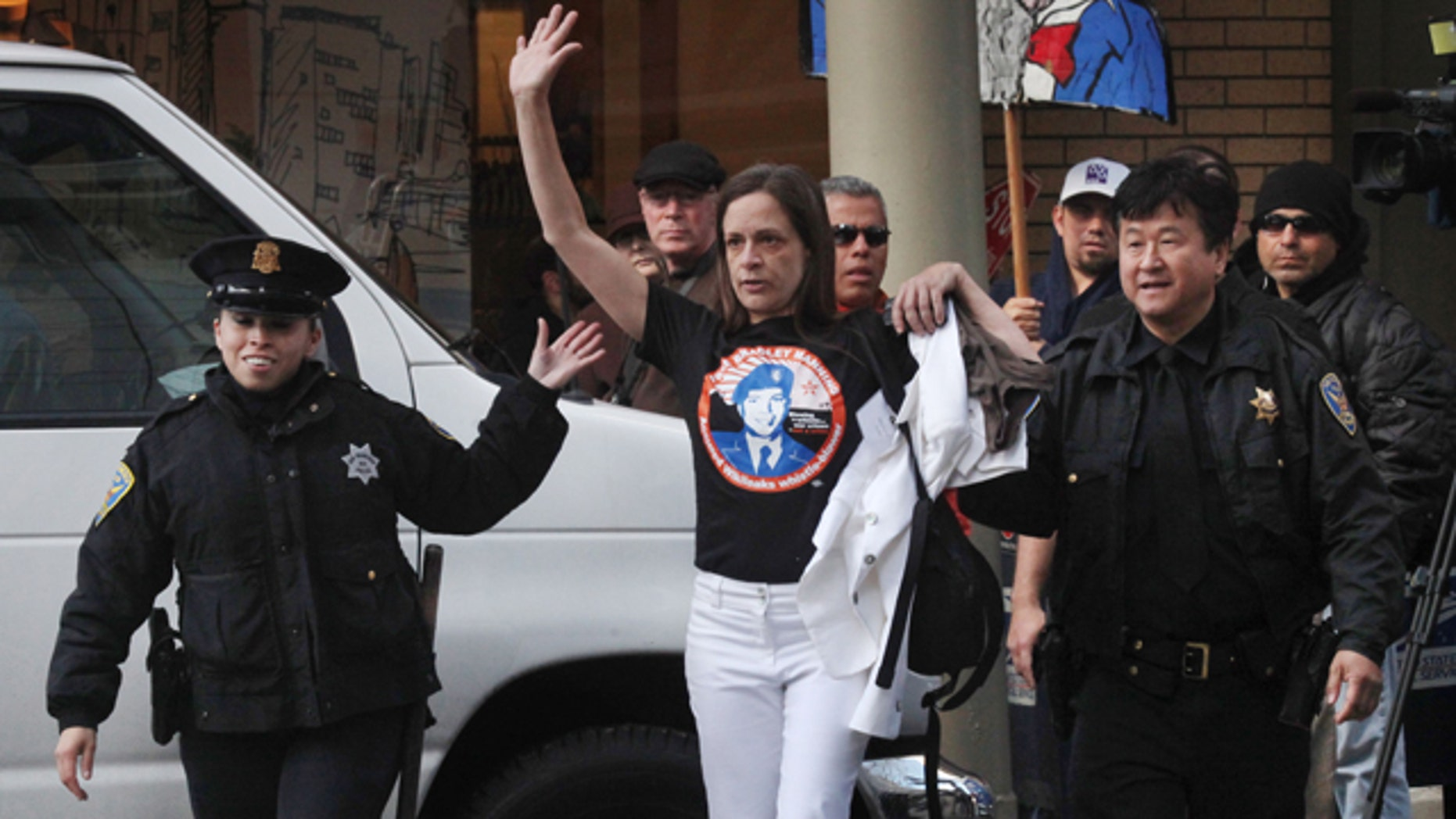 April 21: Naomi Pitcairn of Oakland is escorted by San Francisco Police Officers after protesting at a fundraiser fro President Barack Obama at the St. Regis in San Francisco, Calif.
