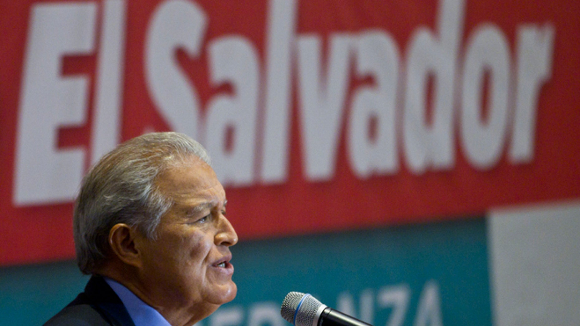 President-elect Salvador Sánchez Céren, of the ruling Farabundo Marti National Liberation Front (FMLN), speaks during a press conference one day after a presidential runoff election in San Salvador, El Salvador, Monday, March 10, 2014. (AP Photo/Esteban Felix)
