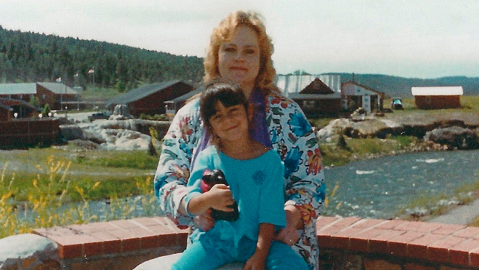 Laura Miera is seen with her daughter Cassandra. In 2002, a tractor-trailer overturned, burying Laura Miera's car in sand and suffocating her inside, in Albuquerque, N.M.