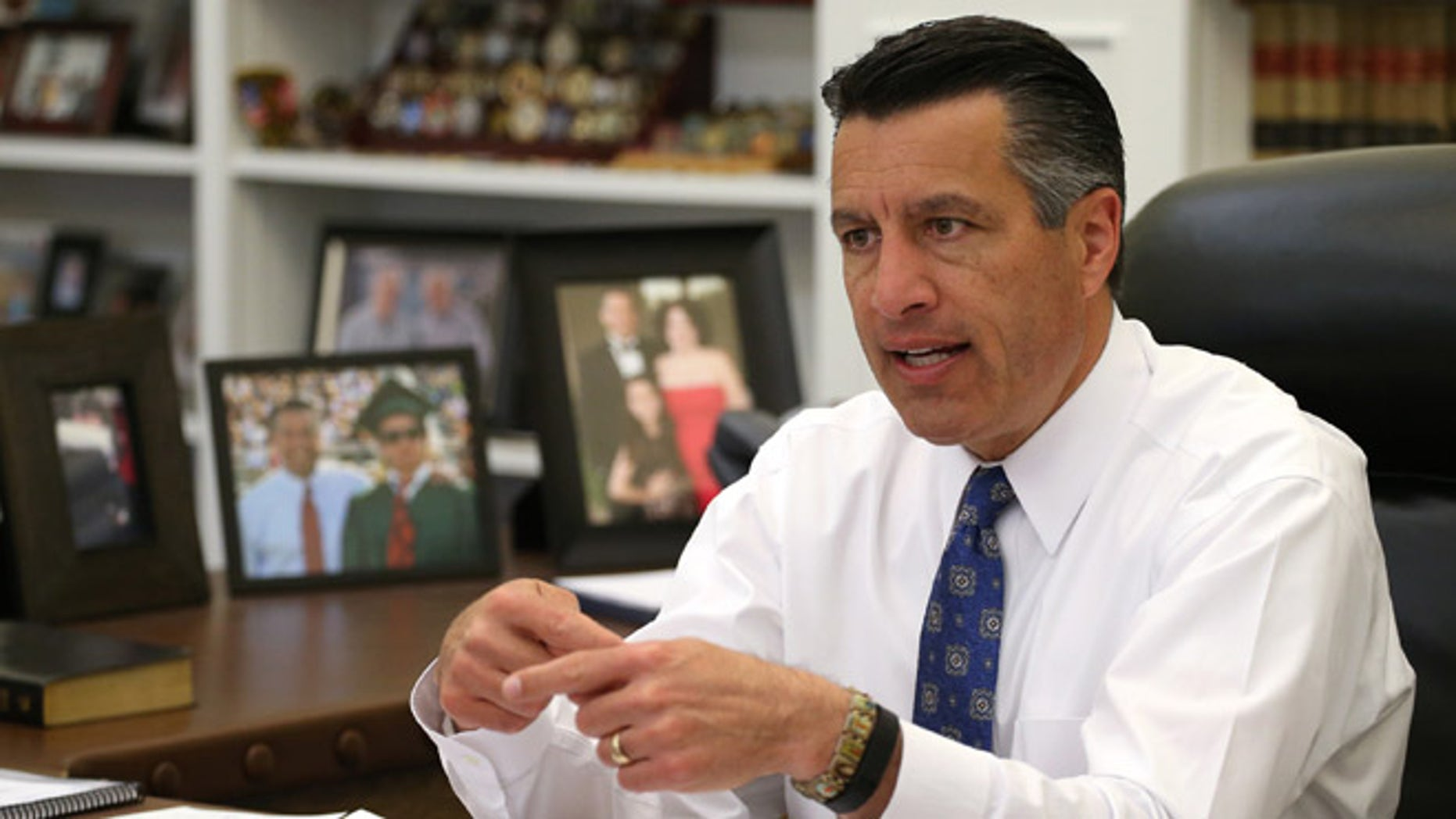Nevada Gov. Brian Sandoval talks about the ongoing legislative session from his office at the Capitol in Carson City, Nev., on Friday, April 17, 2015. Sandoval says he's optimistic that lawmakers will reach a deal on the state's budget. (AP Photo/Cathleen Allison)