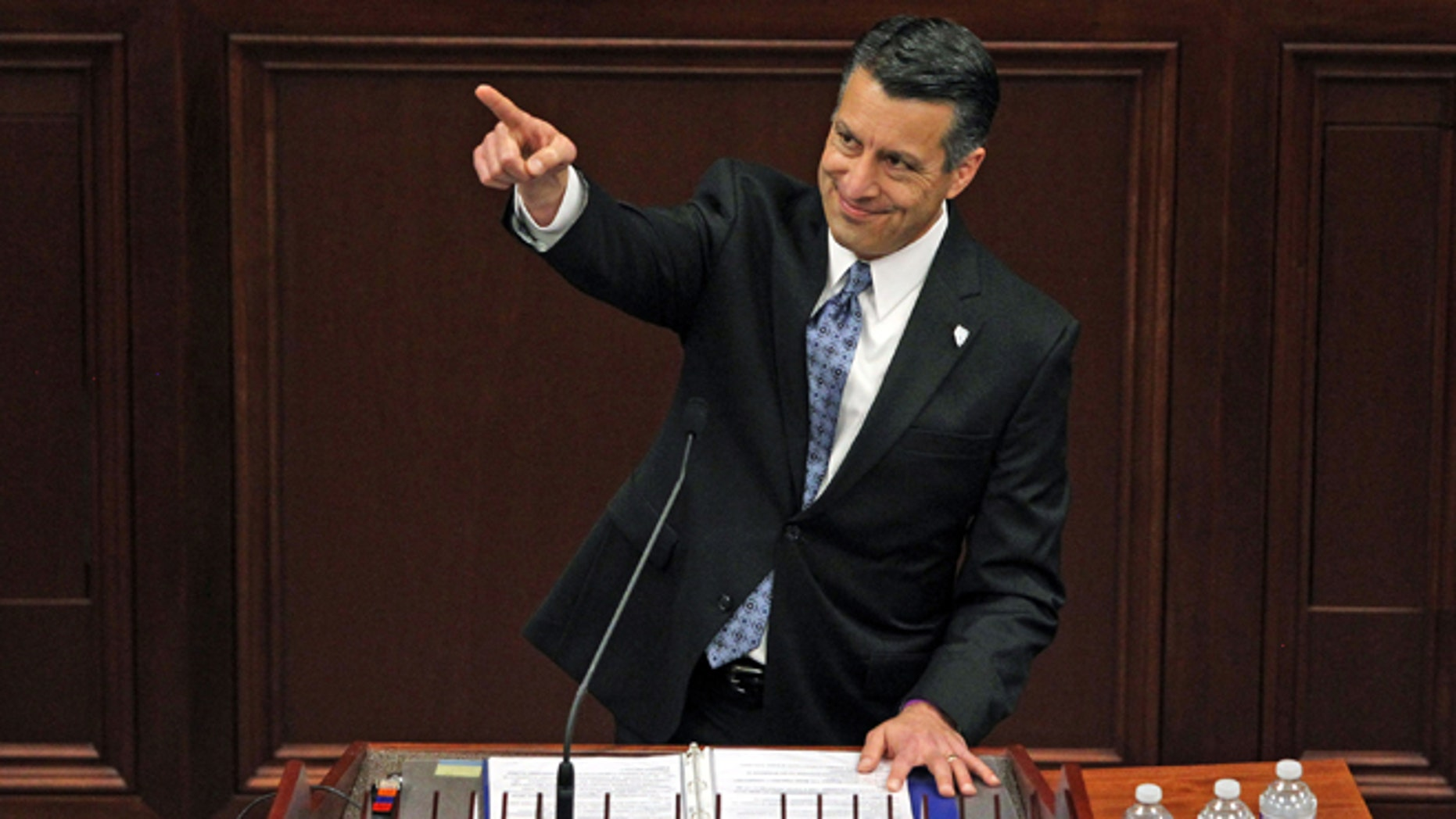 File - In a Thursday, Jan. 15, 2015 file photo, Nevada Gov. Brian Sandoval acknowledges a guest in the gallery during his State of the State address inside the Legislature building on the capital grounds in Carson City, Nev. Sandoval, who swept in to office with 71 percent of the vote, faces anger from other elected constitutional officers and several conservative Assembly members upset with his $7.3 billion, two-year budget that includes $1.1 billion in new and extended taxes.  (AP Photo/Lance Iversen, File)