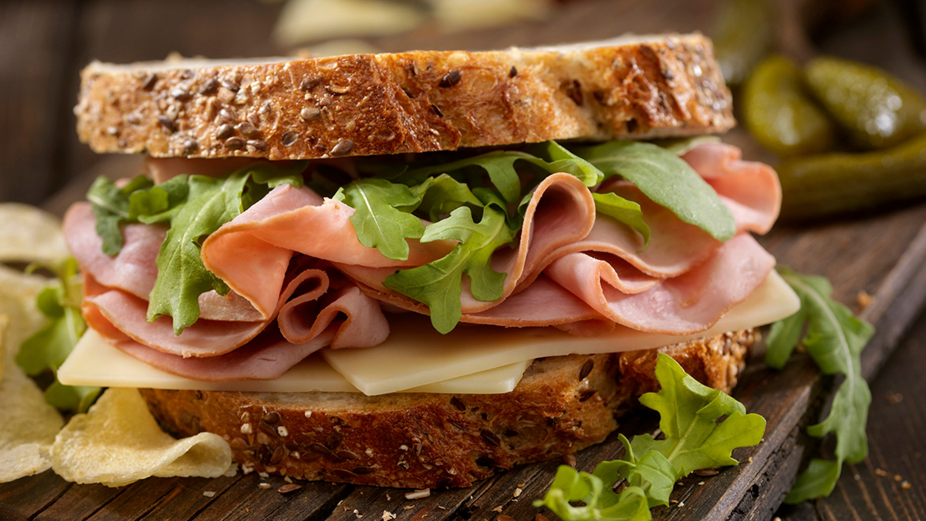 The factory worker was discovered putting powder on a co-worker's sandwich, according to police.