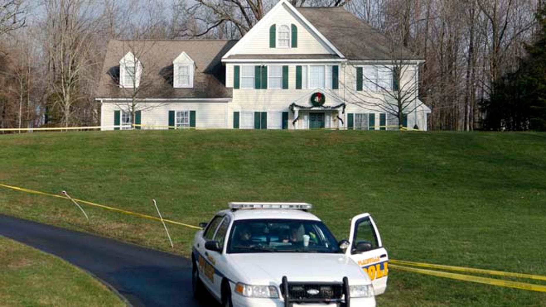 Dec. 18, 2012: A police cruiser sits in the driveway of the home of Nancy Lanza in Newtown, Conn.