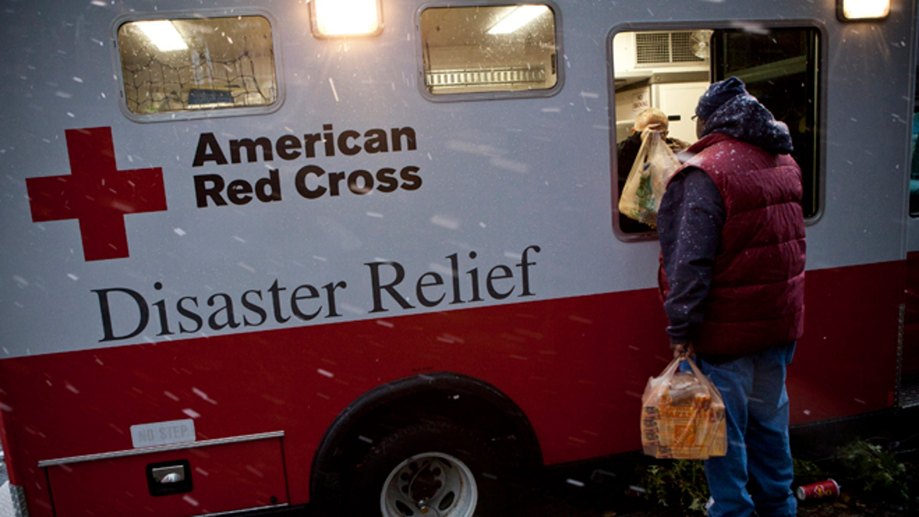 FILE:  Nov. 7, 2012: A Hurricane Sandy victim receives a meal from an American Red Cross Disaster Relief truck, Red Hook, N.Y.