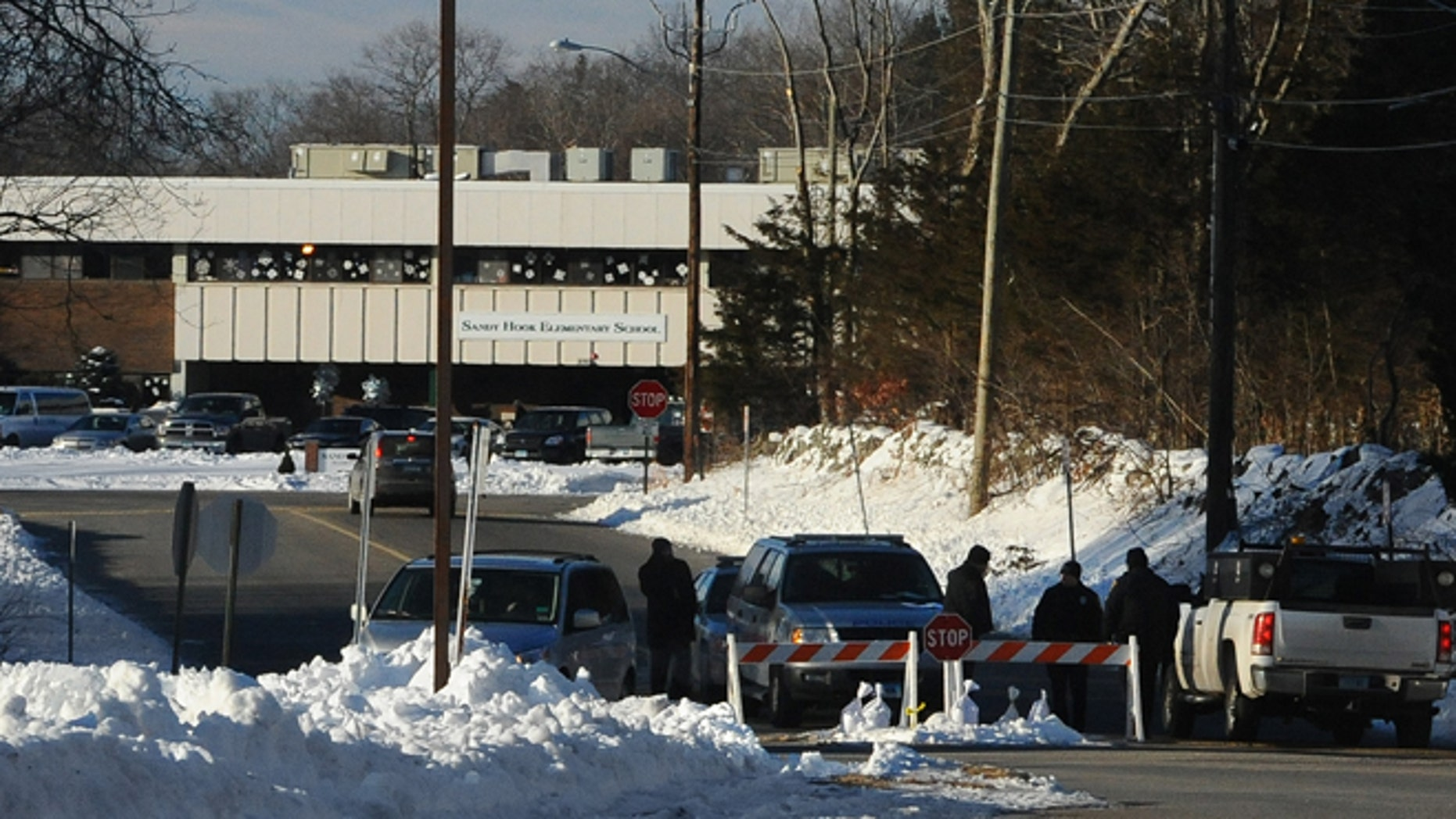 Jan. 3: Police road block is at the entrance to the new Sandy Hook Elementary School on the first day of classes in Monroe, Conn.
