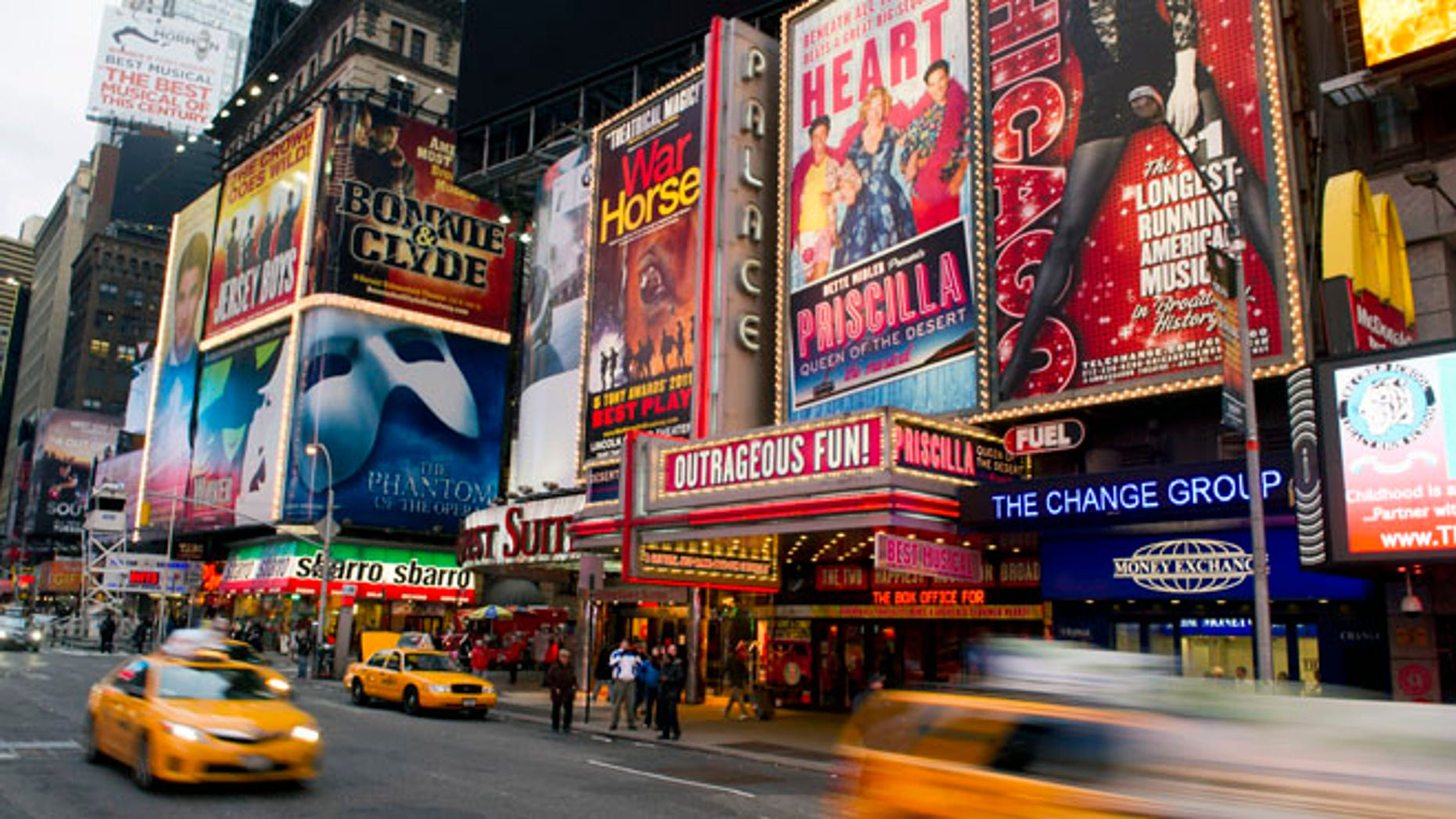 Jan. 19, 2012: This file photo shows billboards advertising Broadway shows in Times Square, in New York.