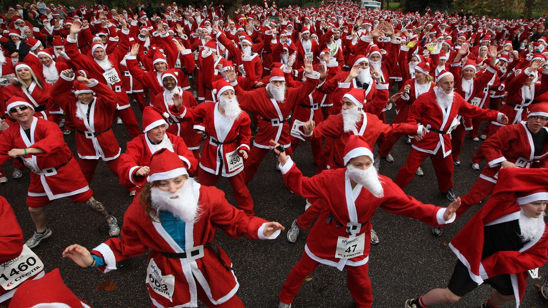 Charity runners dressed as Santa Claus warm up before taking part in the Disability Snowport UK fun run in London, England. (Photo by Peter Macdiarmid/Getty Images)