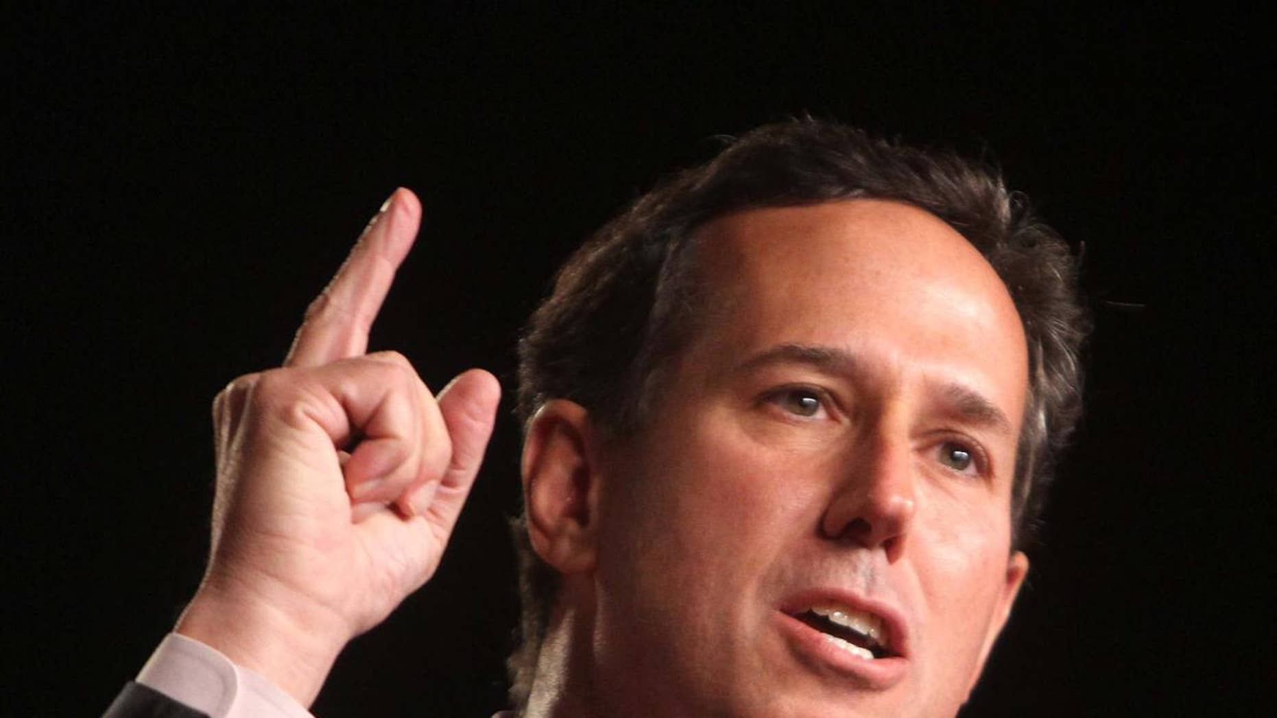 Republican presidential candidate Rick Santorum addresses the Conservative Political Action Conference (CPAC) at the Orange County Convention Center in Orlando, Fla., Friday, Sept. 23, 2011. (AP Photo/Joe Burbank, Pool)