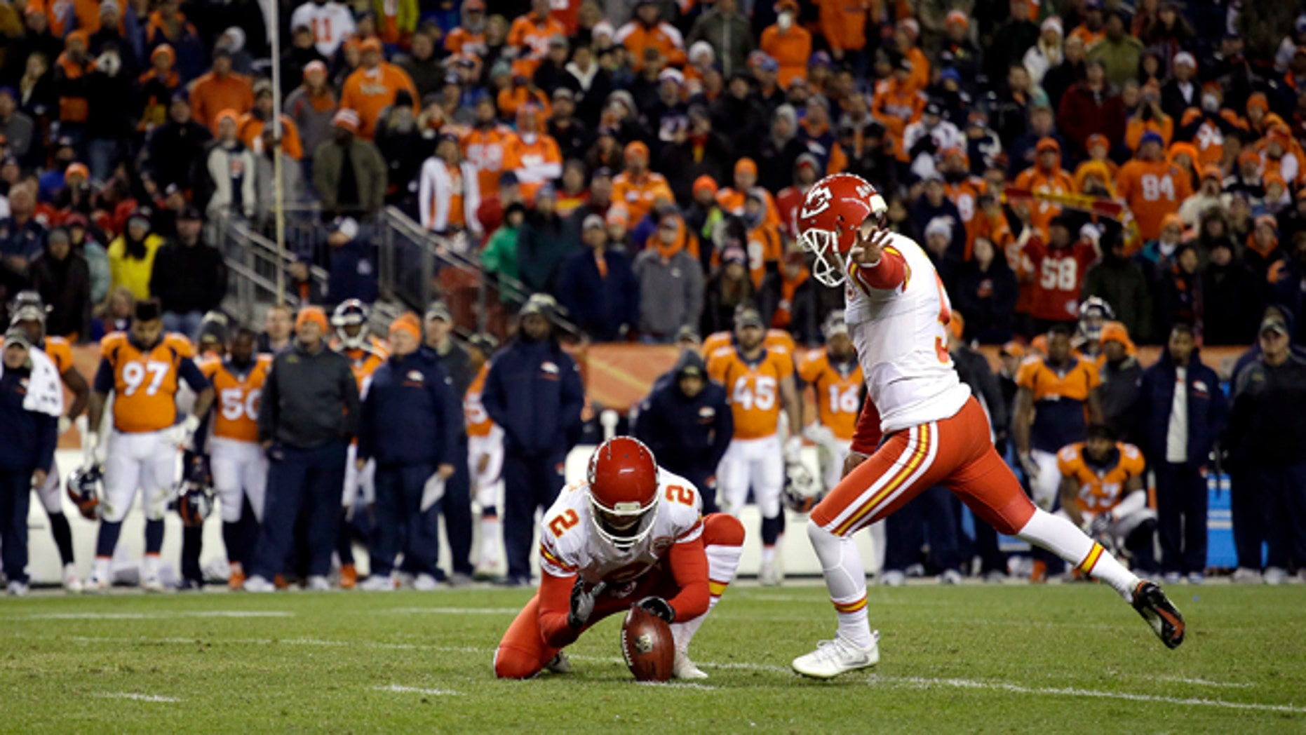 Kansas City Chiefs kicker Cairo Santos (5) kicks the game winning field goal as punter Dustin Colquitt (2) holds during overtime of an NFL football game against the Denver Broncos, Sunday, Nov. 27, 2016, in Denver. The Chiefs won 30-27 in overtime. (AP Photo/Joe Mahoney)