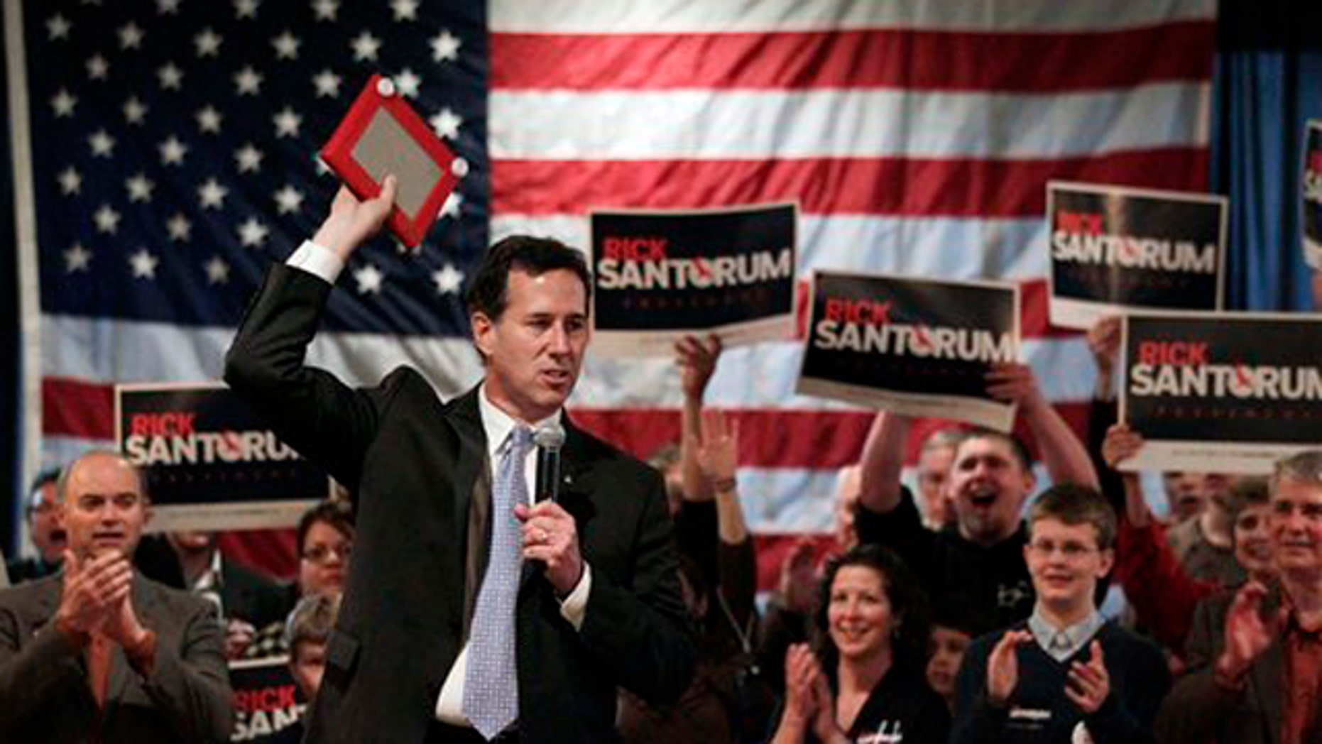 Mar. 24, 2012: Republican presidential candidate, former Pennsylvania Sen. Rick Santorum addresses supporters during a campaign rally in Bellevue, Wis.