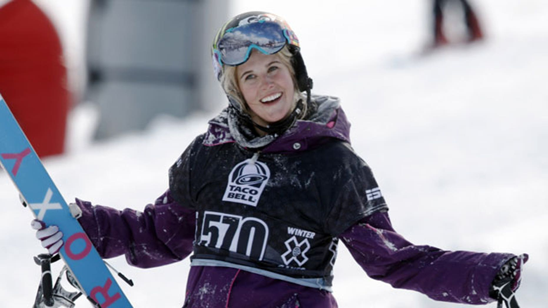 In a Jan. 28, 2010, file photo, Sarah Burke, of Canada, reacts after failing to place in the top-three finishers in the slopestyle skiing women's final at the Winter X Games at Buttermilk Mountain outside Aspen, Colo.