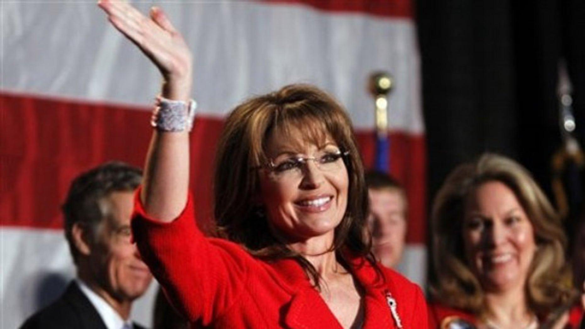 May 2: Former Alaska Governor Sarah Palin waves during a fund raiser at Colorado Christian University in Lakewood, Colo. (AP).