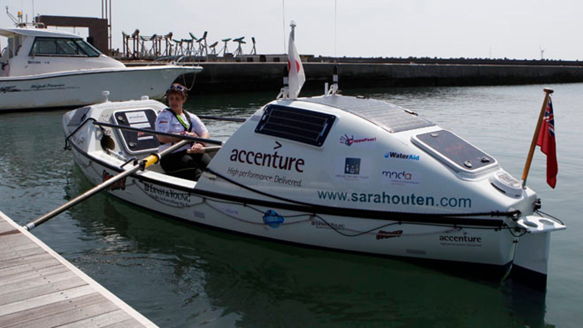 April 4, 2013: Briton Sarah Outen rows her boat at a port in Chosi, east of Tokyo April 4, 2013.