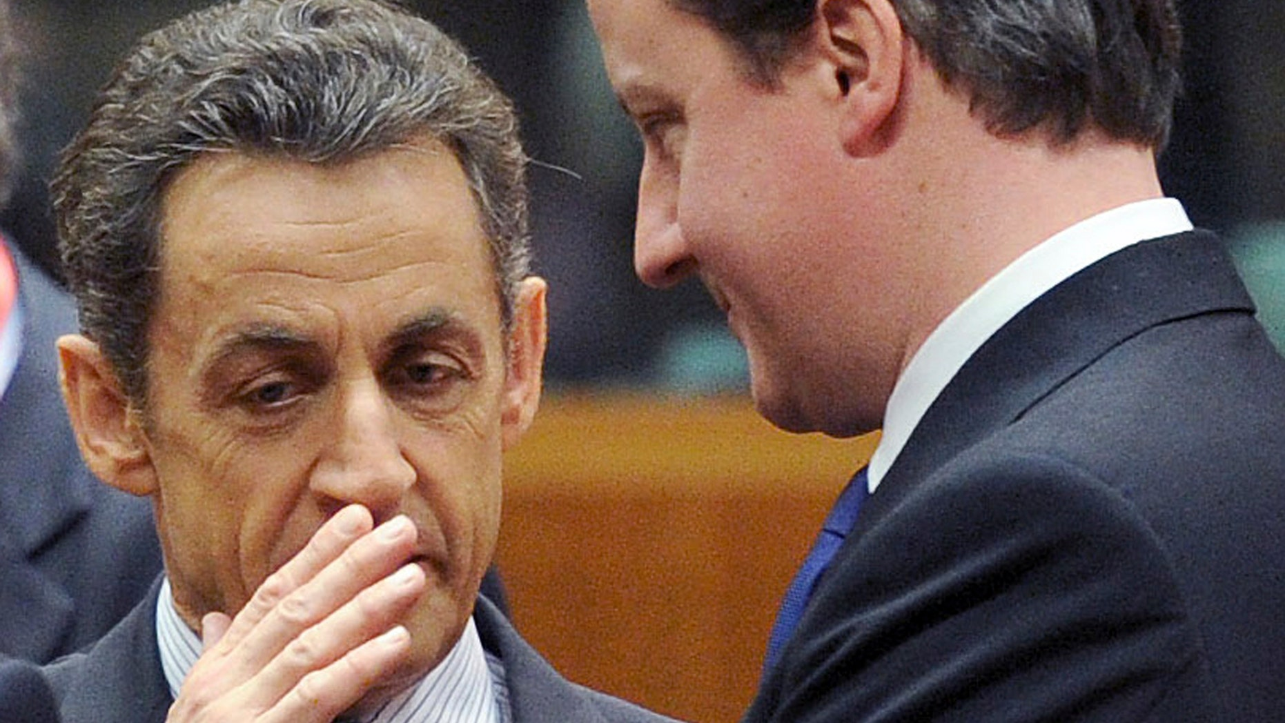 March 11: French President Nicolas Sarkozy, left, speaks with British Prime Minister David Cameron during an EU Summit in Brussels.