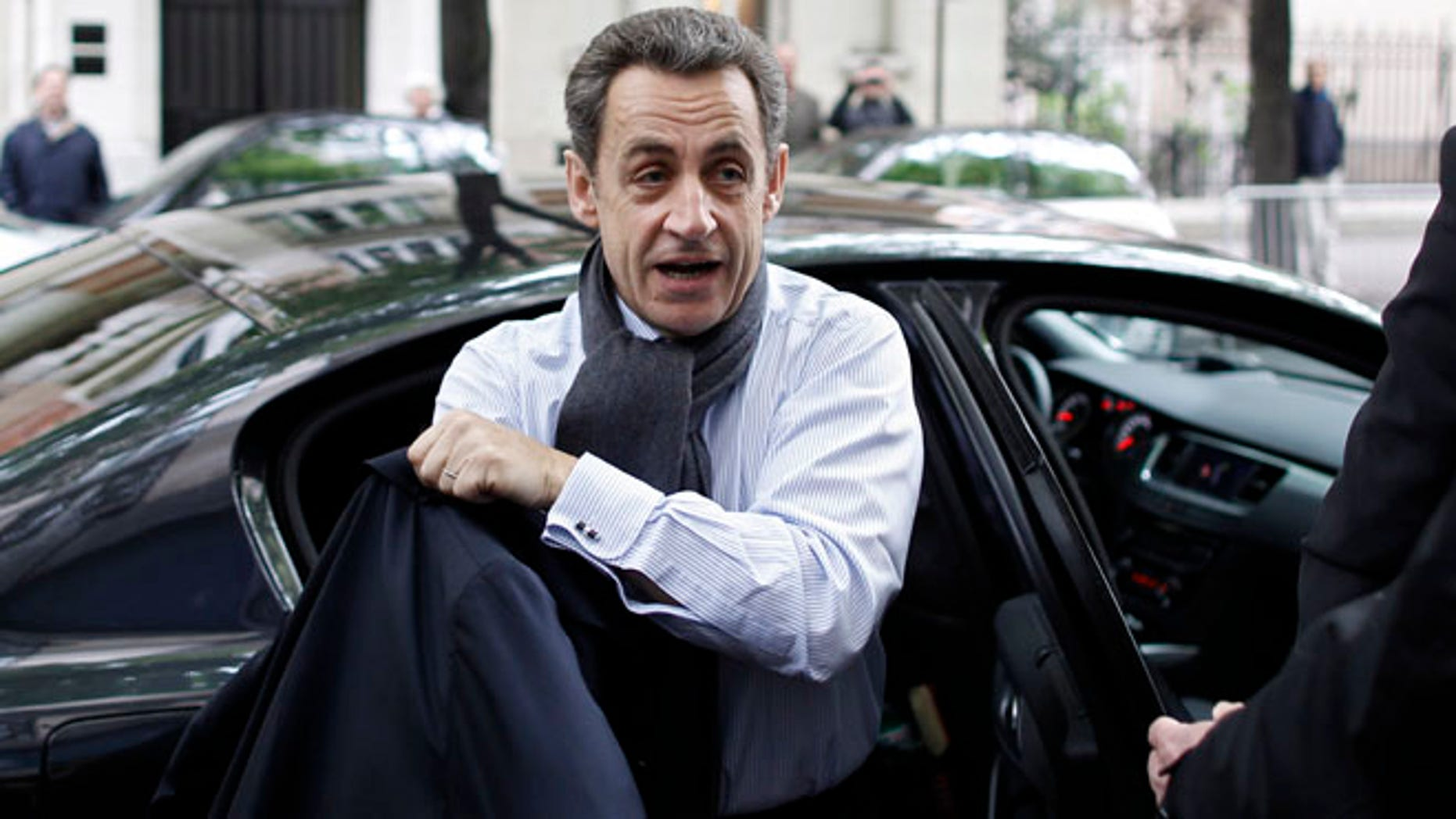 April 23: French President and UMP party candidate for the elections Nicolas Sarkozy arrives at his campaign headquarters the morning after the first round of voting in Paris.