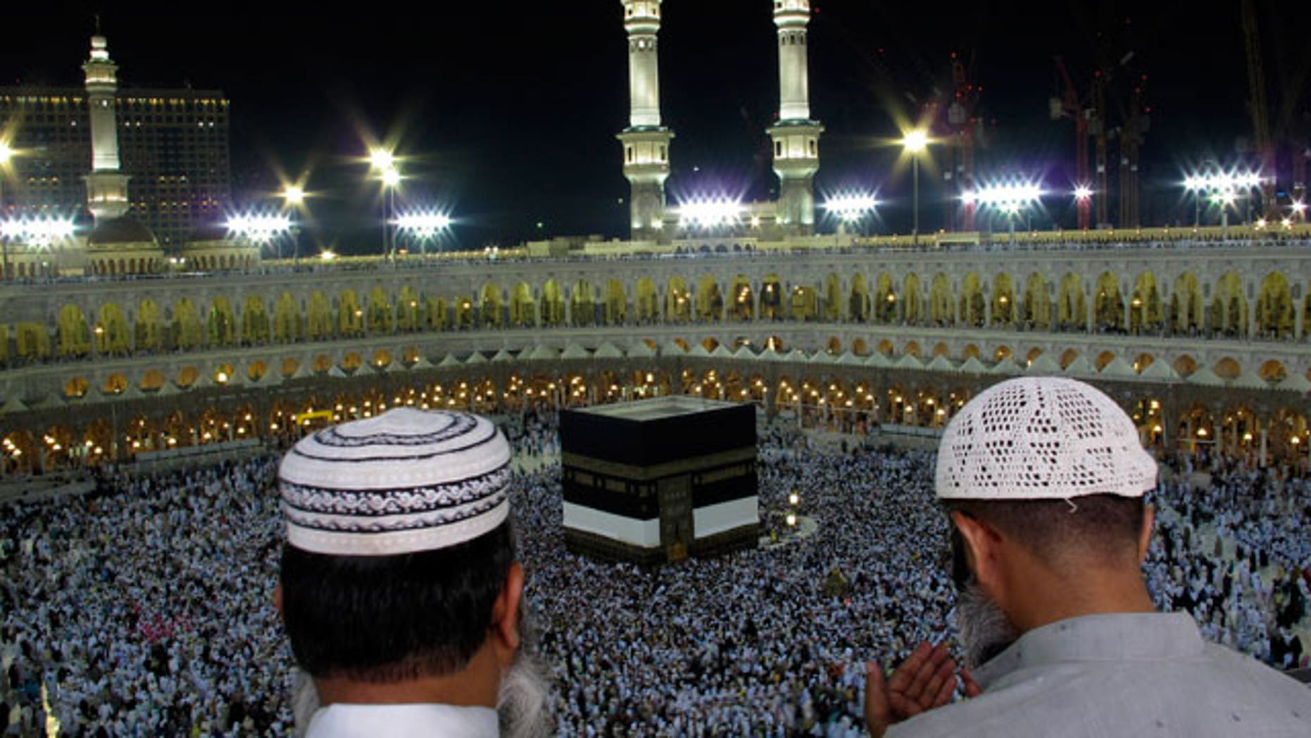 Muslim pilgrims pray as tens of thousands of Muslim pilgrims moving around the Kaaba, the black cube seen at center, inside the Grand Mosque, during the annual Hajj Mecca, Saudi Arabia, Wednesday, Nov. 10, 2010. The annual Islamic pilgrimage draws 3 million visitors each year, making it the largest yearly gathering of people in the world.