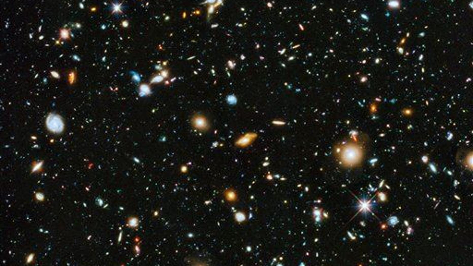 There are around 10,000 multi-colored galaxies in this Hubble Space Telescope image.
