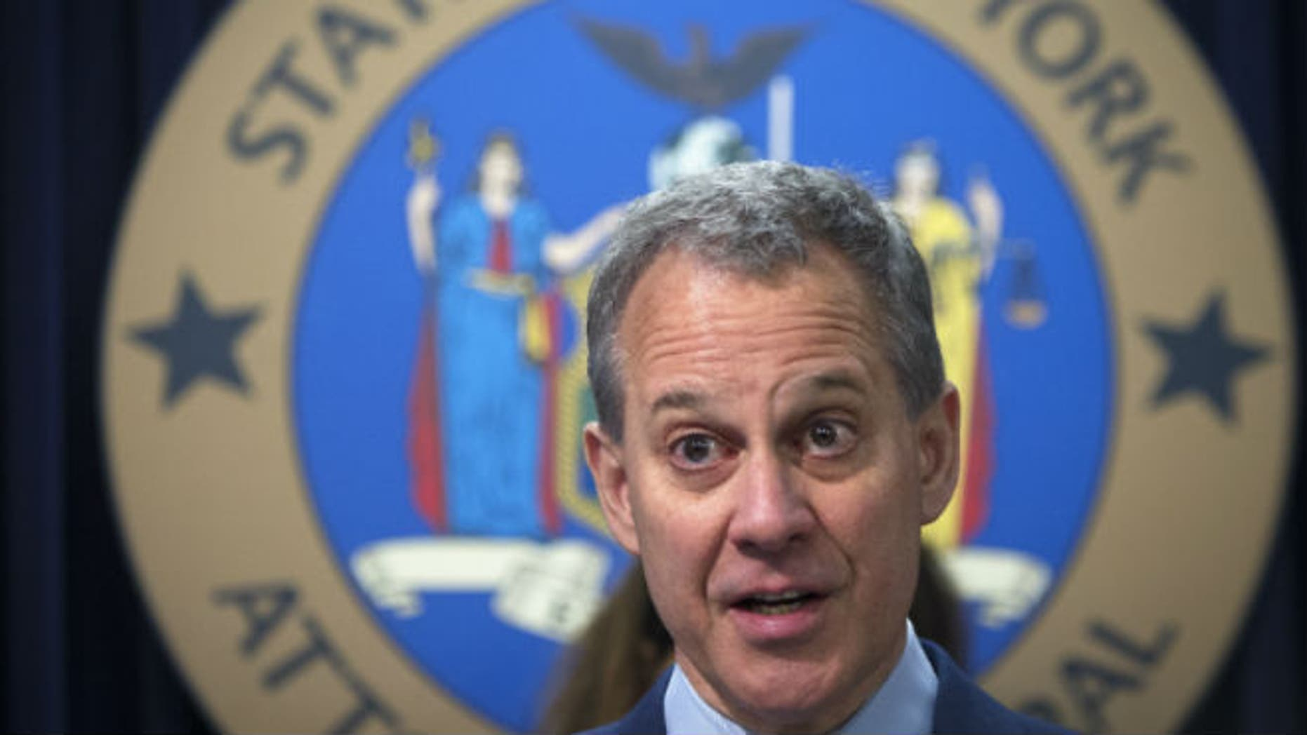 New York State Attorney General Eric Schneiderman speaks during a news conference in the Manhattan borough of New York in this file photo dated August 21, 2014. REUTERS/CARLO ALLEGRI