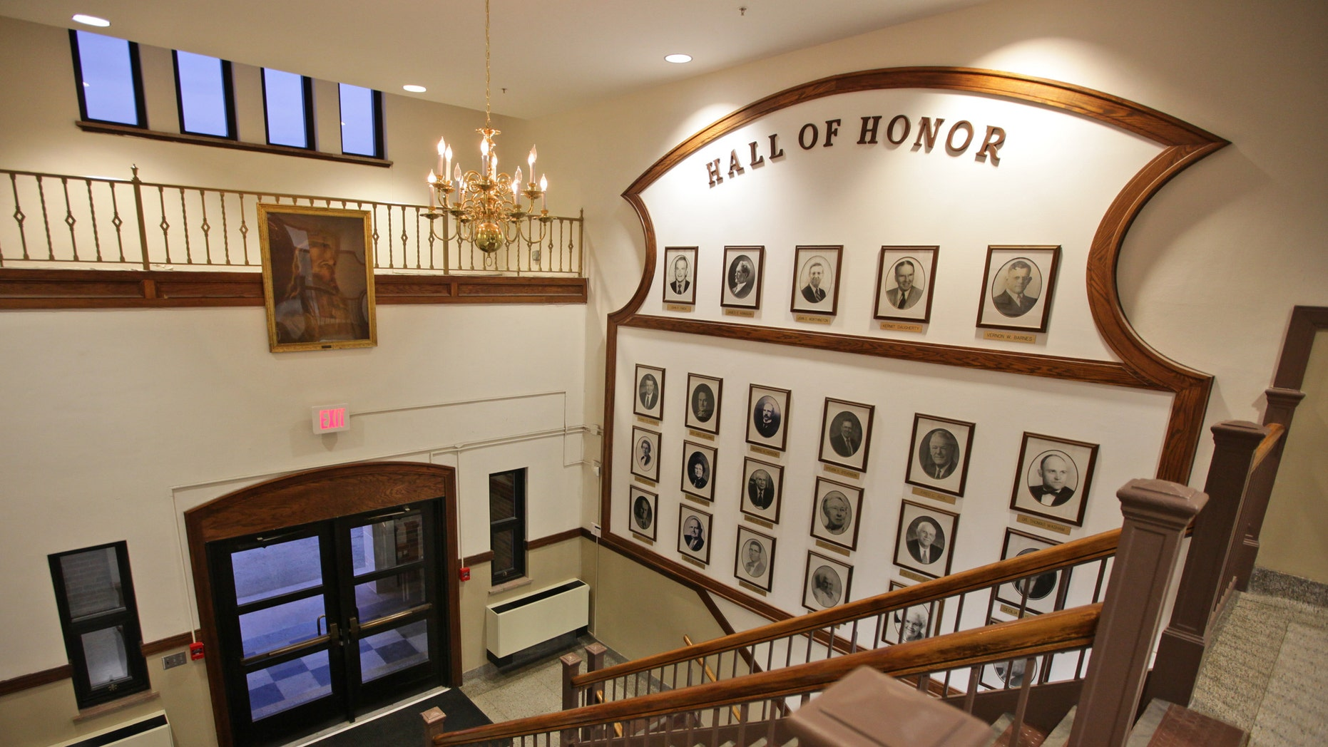 """Feb. 12, 2013: This photo shows a painting of Jesus Christ, upper left, hanging above an entrance to Jackson Middle School in Jackson, Ohio, next to a """"Hall of Honor"""" showing famous Jackson residents and school alumni."""