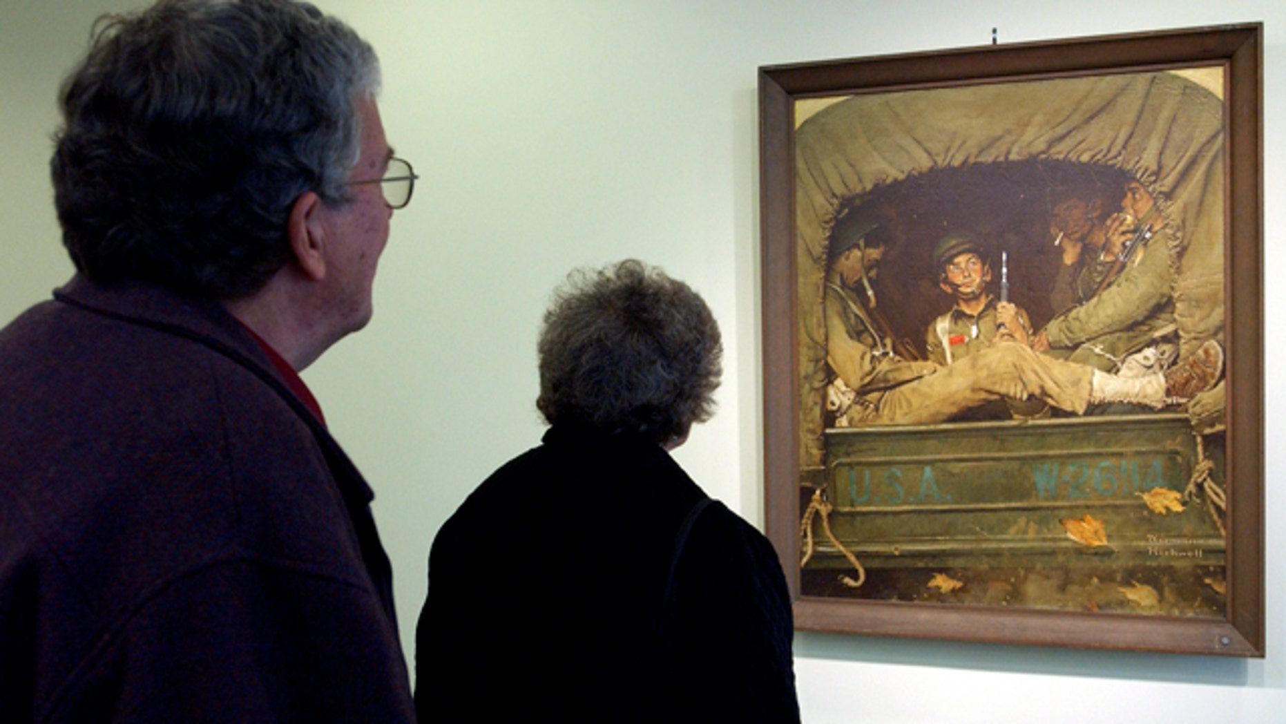 May 22, 2005: This May 22, 2005 photo shows the the restored Norman Rockwell illustration 'Willie Gillis In Convoy' on display at the Levi Heywood Memorial Library in Gardner, Mass.  (AP Photo/Worcester Telegram & Gazette, Rick Cinclair)
