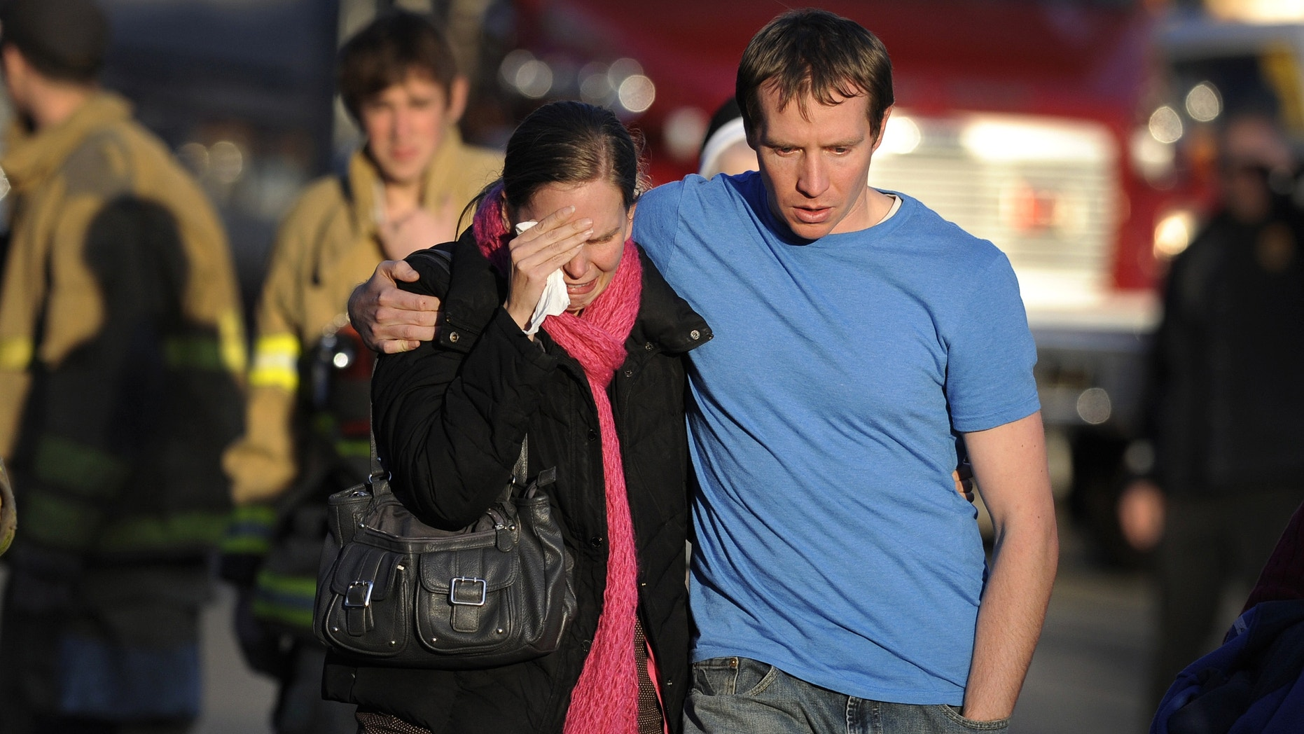 In this Dec. 14, 2012 file photo, Alissa Parker, left, and her husband, Robbie Parker,  leave the firehouse staging after receiving word that their six-year-old daughter Emilie was one of the 20 children killed in the Sandy Hook School shooting in Newtown, Conn.