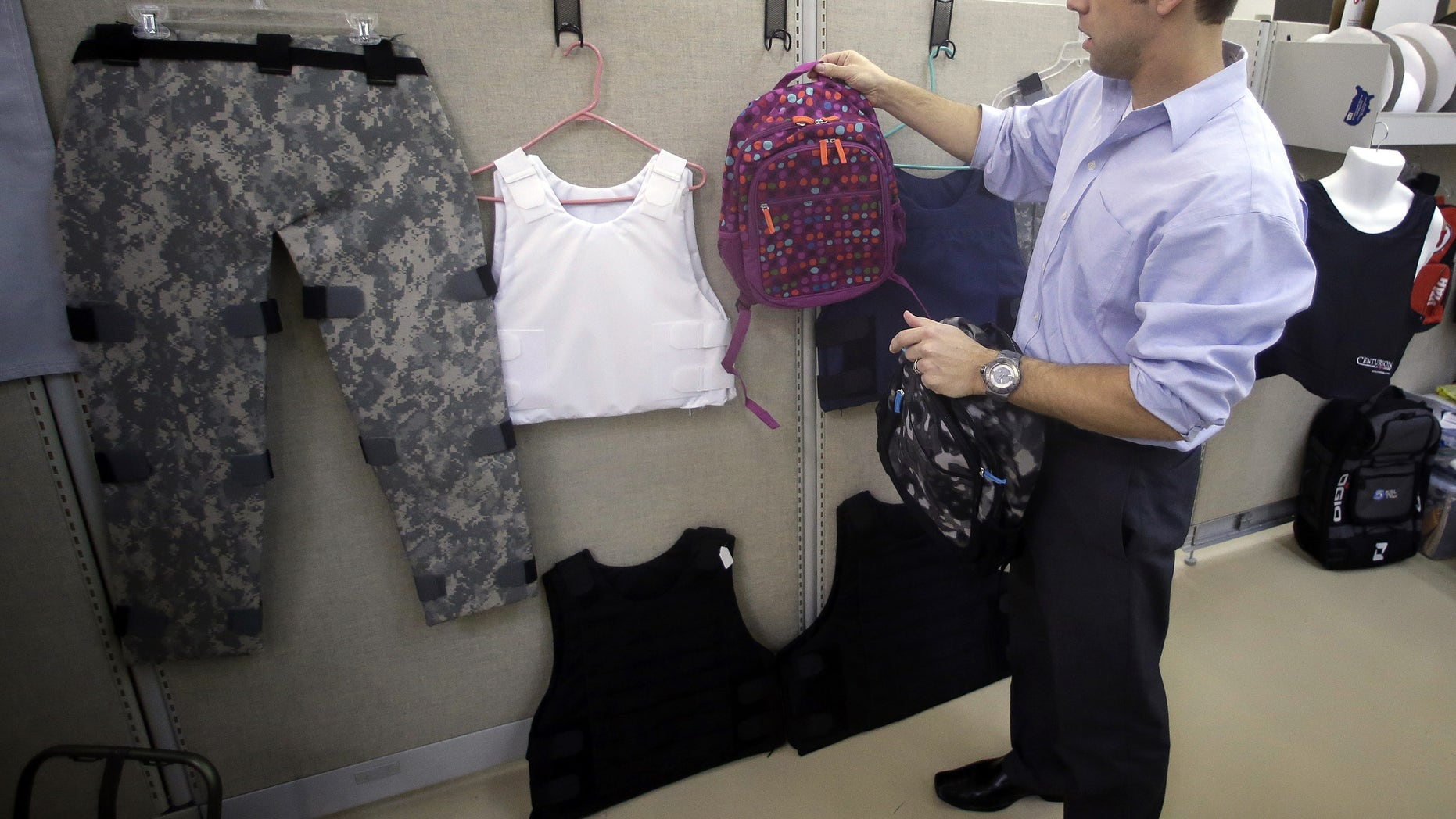 Dec. 19, 2012: Rick Brand, Chief Operating Officer of Amendment II, holds a children's backpack with anti-ballistic insert during at the company's manufacturing facility in Salt Lake City.