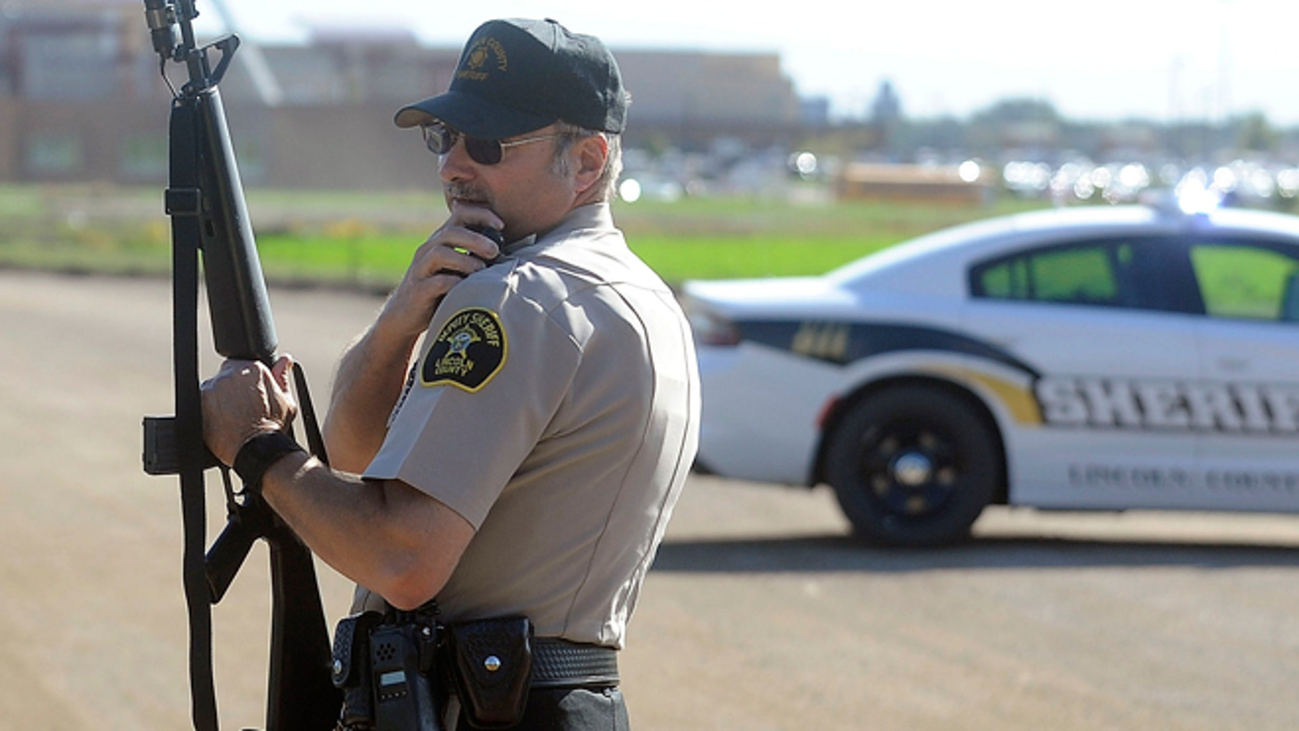 Lincoln County Sgt. Sheriff Terry Anderson guards the entrance of Harrisburg High School.
