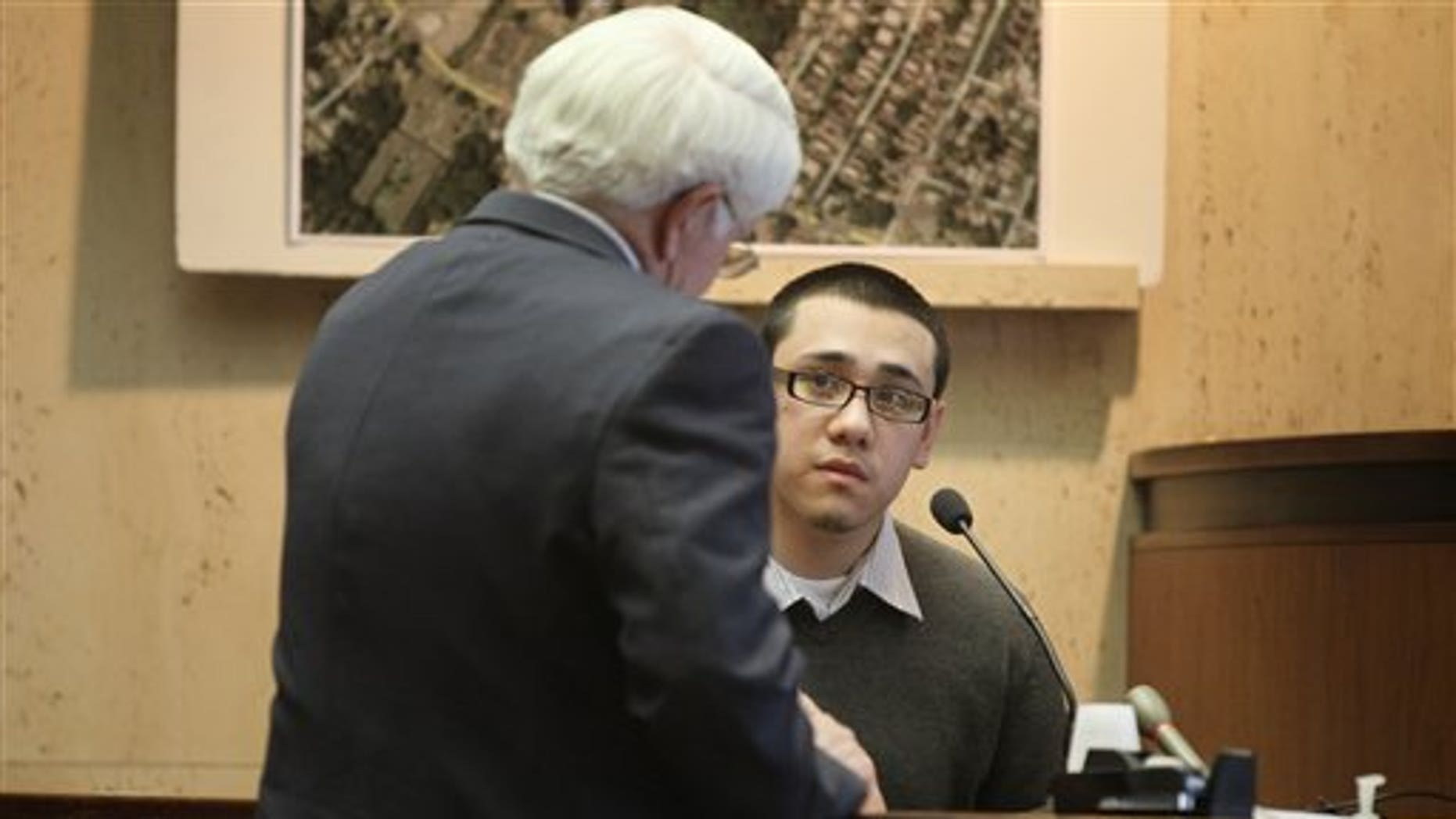Alexander Alfaro being cross examined during his trial at the Essex County Courthouse in Newark, N.J., Monday, March 28, 2011.