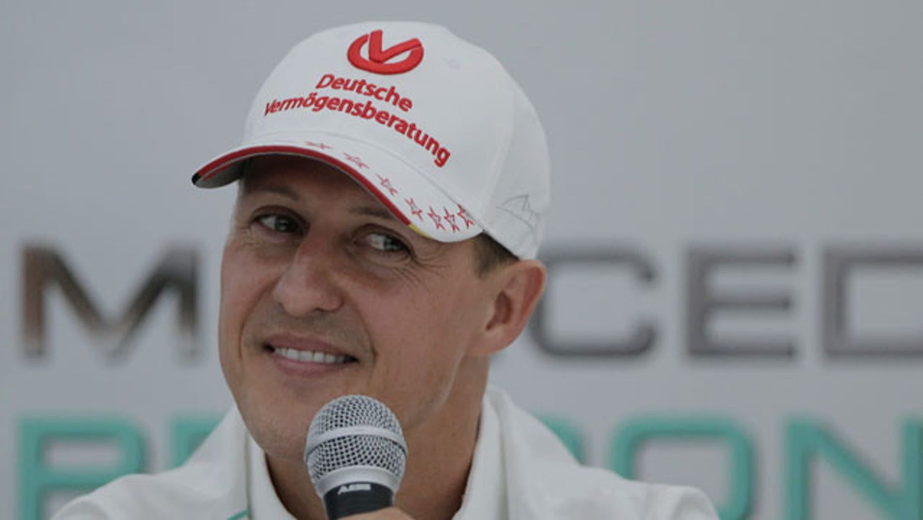 File - Michael Schumacher announces his retirement from Formula One at the end of the 2012 season during a press conference at the Suzuka Circuit venue for the Japanese Formula One Grand Prix in Suzuka, Japan. (AP Photo)
