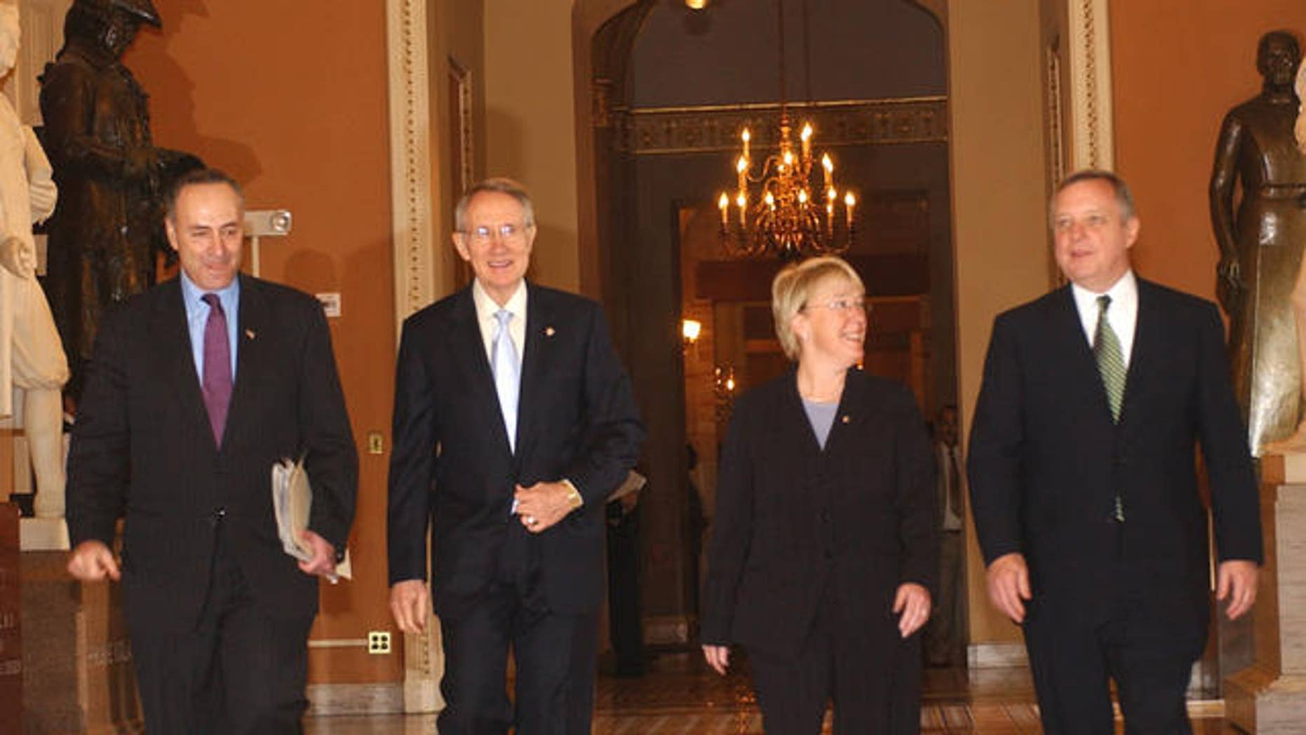 Incoming Senate Majority Leader Harry Reid of Nev., second from left, emerges from a Democratic caucus on Capitol Hill in Washington Tuesday. Nov. 14, 2006, after being elected incoming majority leader of the 110th congress. From left are Sen. Charles Schumer, D-N.Y., elected Democratic Conference vice chair; Reid; Sen. Patty Murray, D-Wash., elected conference secretary, and Sen. Richard Durbin, D-Ill., named assistant majority leader.     (AP Photo/Dennis Cook)