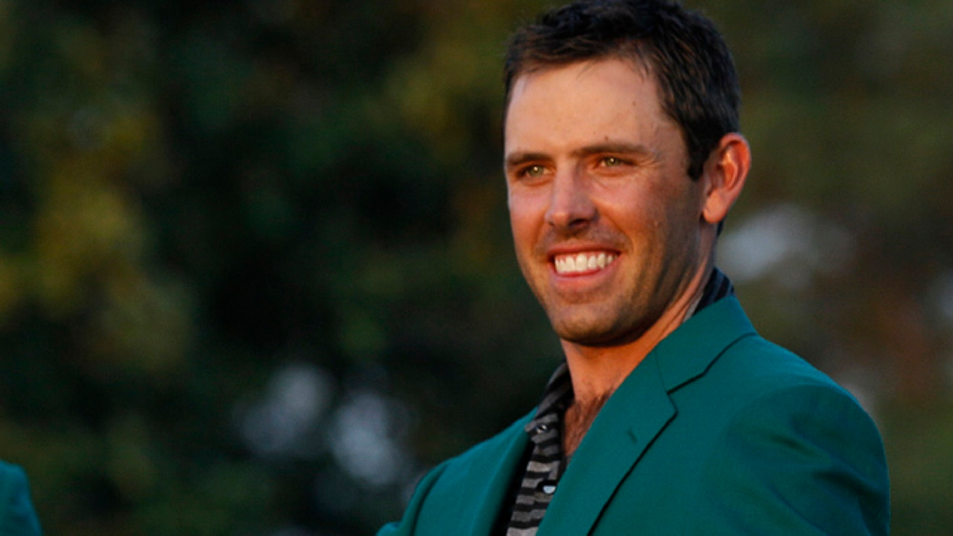 April 10, 2011: Charl Schwartzel of South Africa shows off his green jacket after winning the Masters golf tournament.