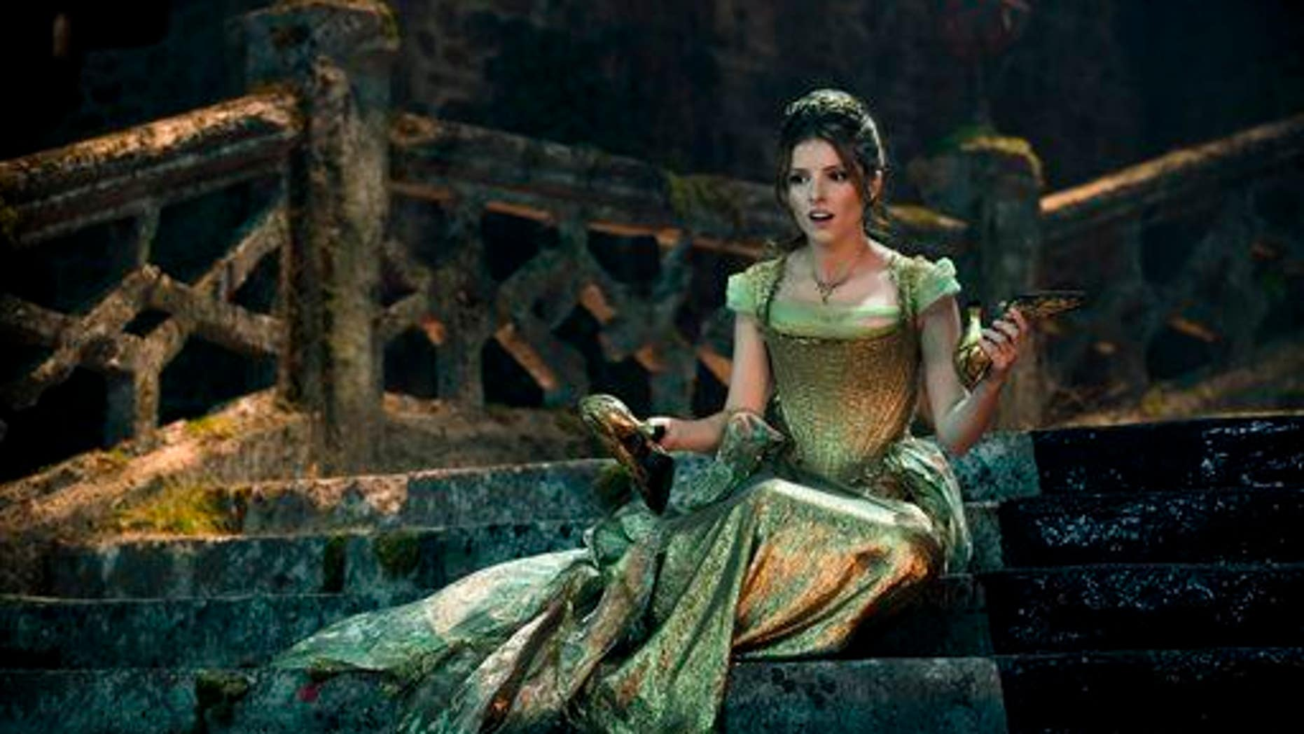 "In this image released by Disney Enterprises, Inc., Anna Kendrick stars as Cinderella in a scene from ""Into the Woods."""