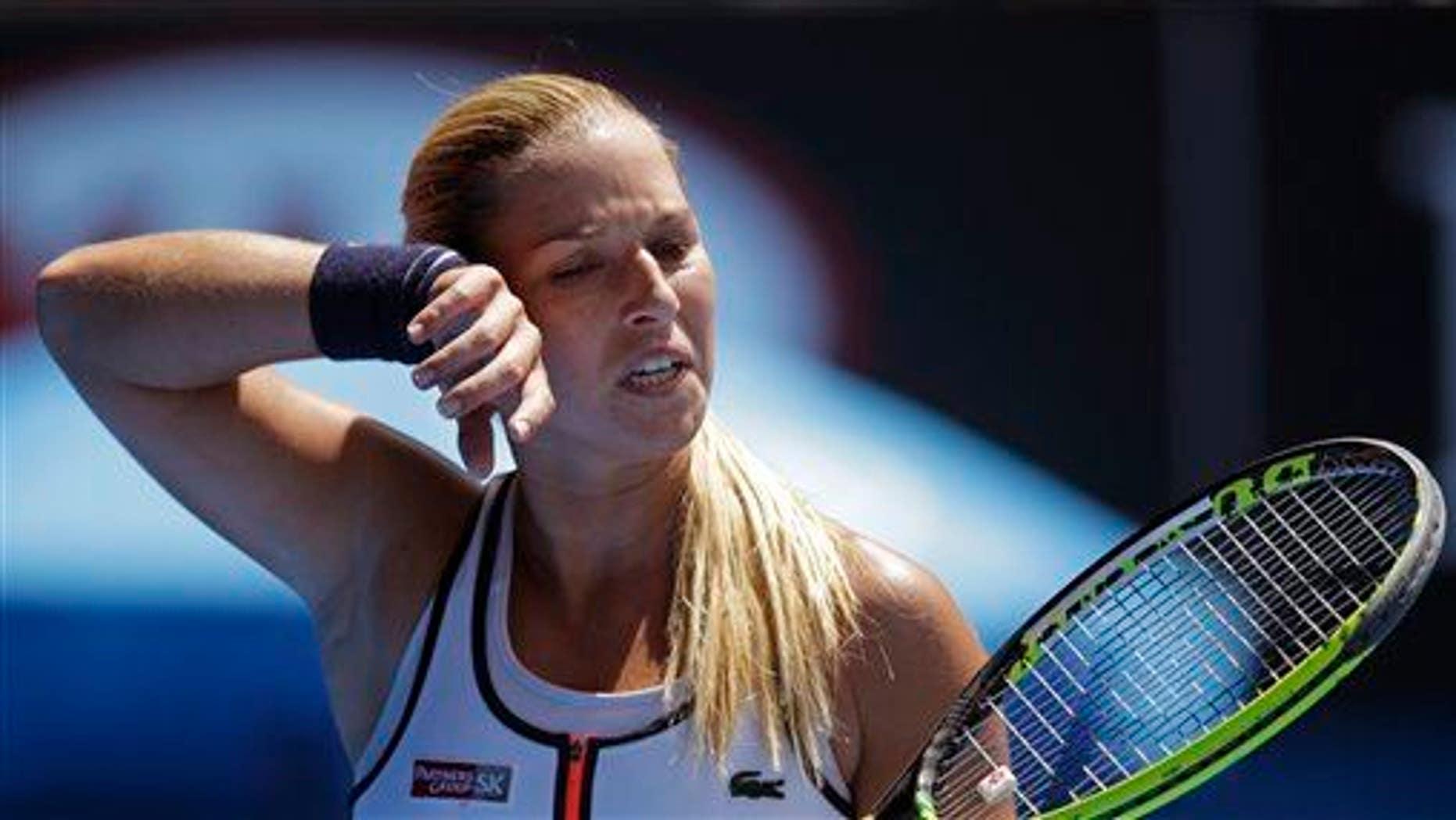 Dominika Cibulkova of Slovakia wipes the sweat from the face as she plays Serena Williams at the Australian Open this year.