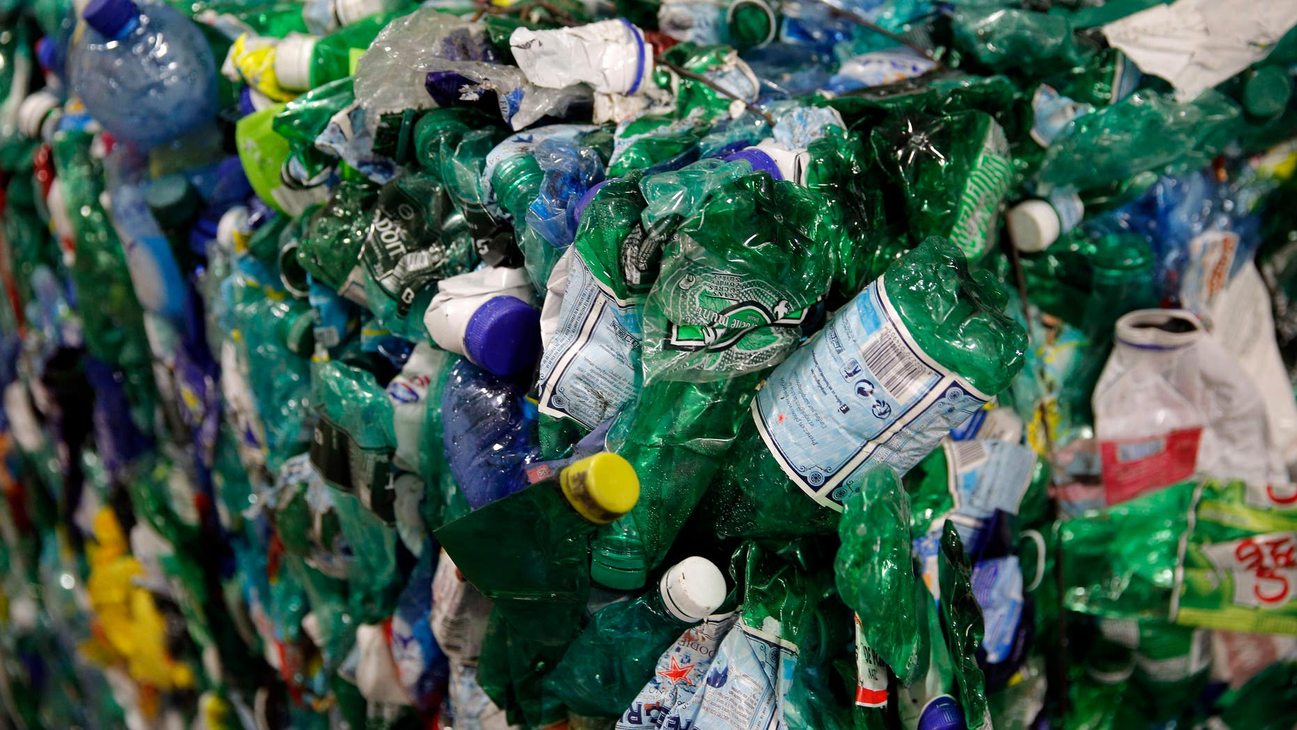 Plastic bottles are compacted at a plant in Paris.