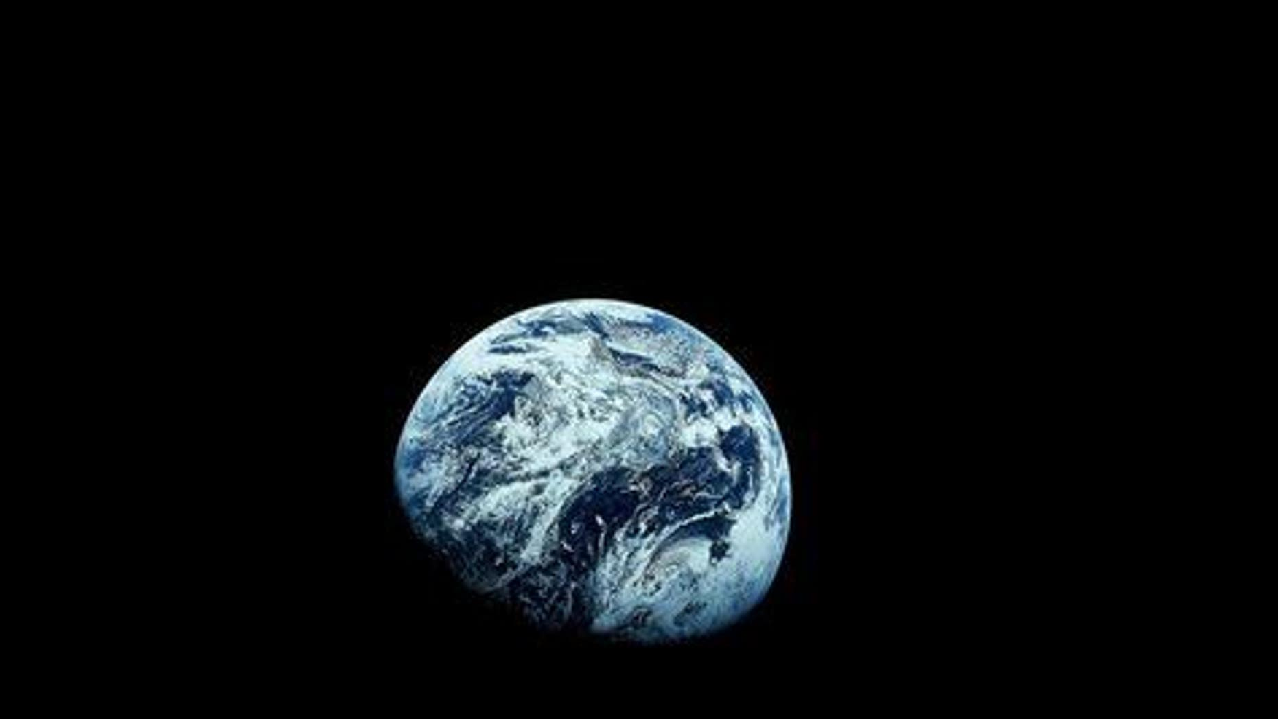 This December 1968 file photo provided by NASA shows Earth as seen from the Apollo 8 spacecraft.