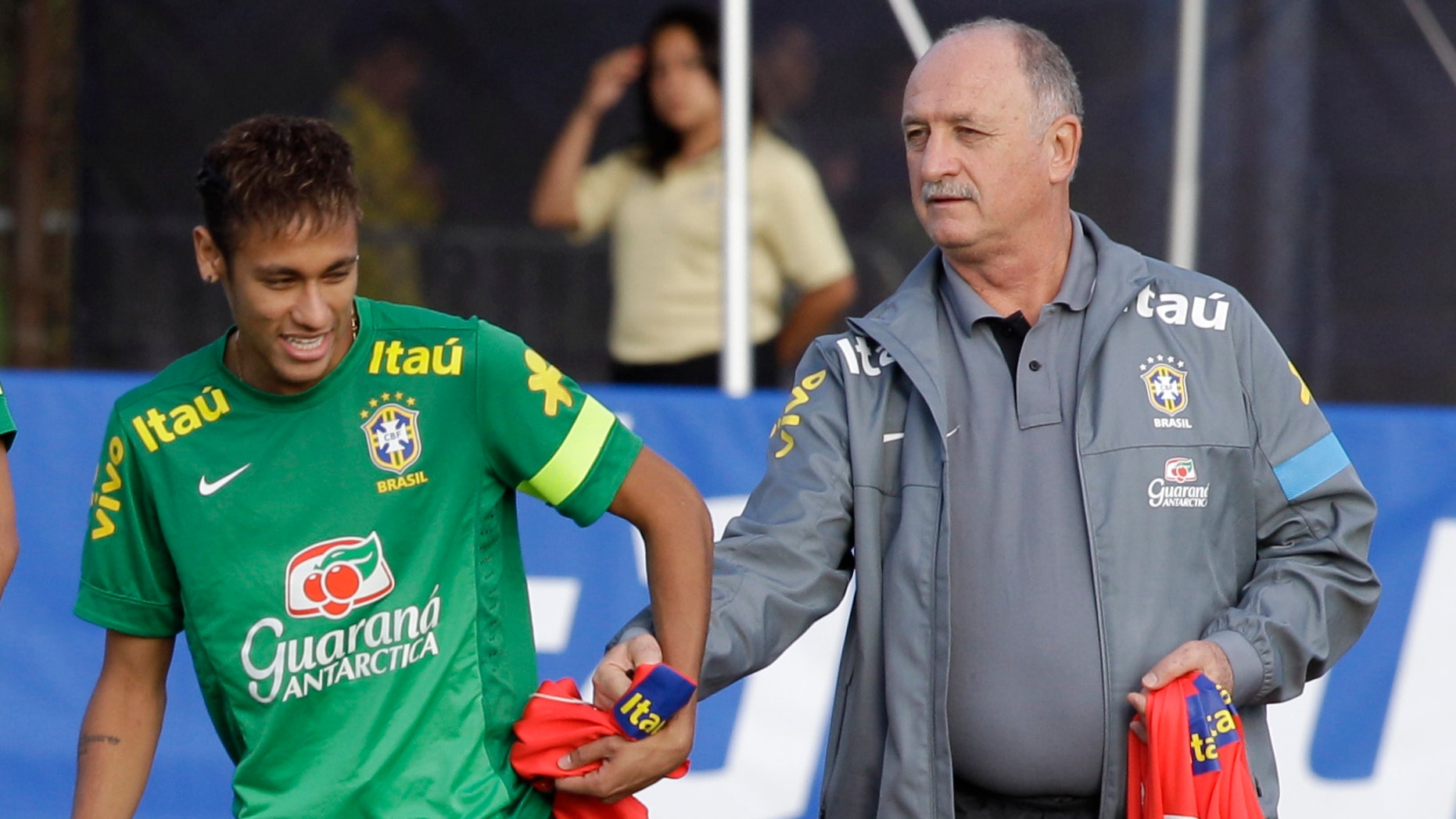 Brazil coach Luis Felipe Scolari, right, with star striker, Neymar, during a national team practice on Nov. 14, 2013 (AP/Javier Galeano)