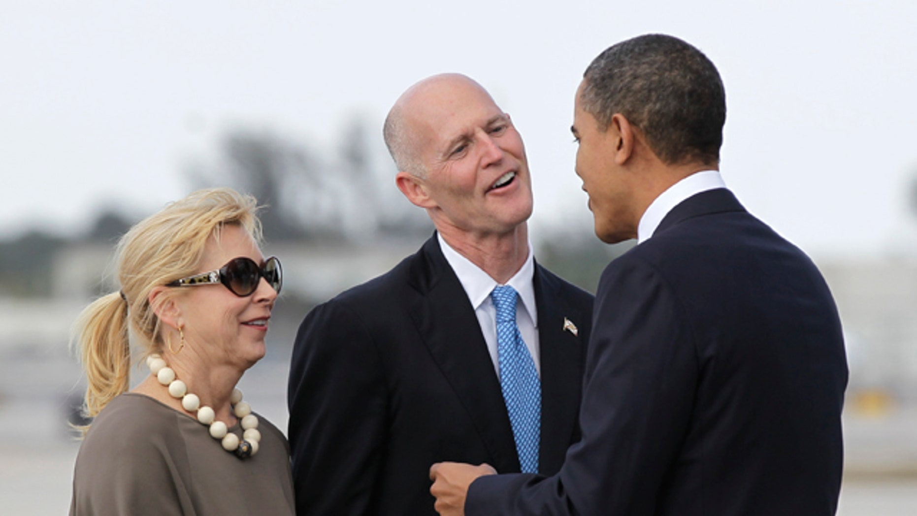 March 4: Obama is greeted by Florida Gov. Rick Scott and his wife Ann upon his arrival to Miami International Airport. U.S. Transportation Secretary Ray LaHood announced March 4 that $2.4 billion in high-speed rail funding intended for Florida will be sent to other states after the state Supreme Court upheld Gov. Rick Scott's decision to reject the money.