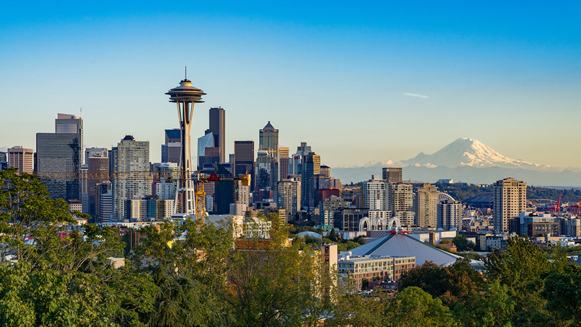The city of Seattle with Mount Rainier behind the cityscape.