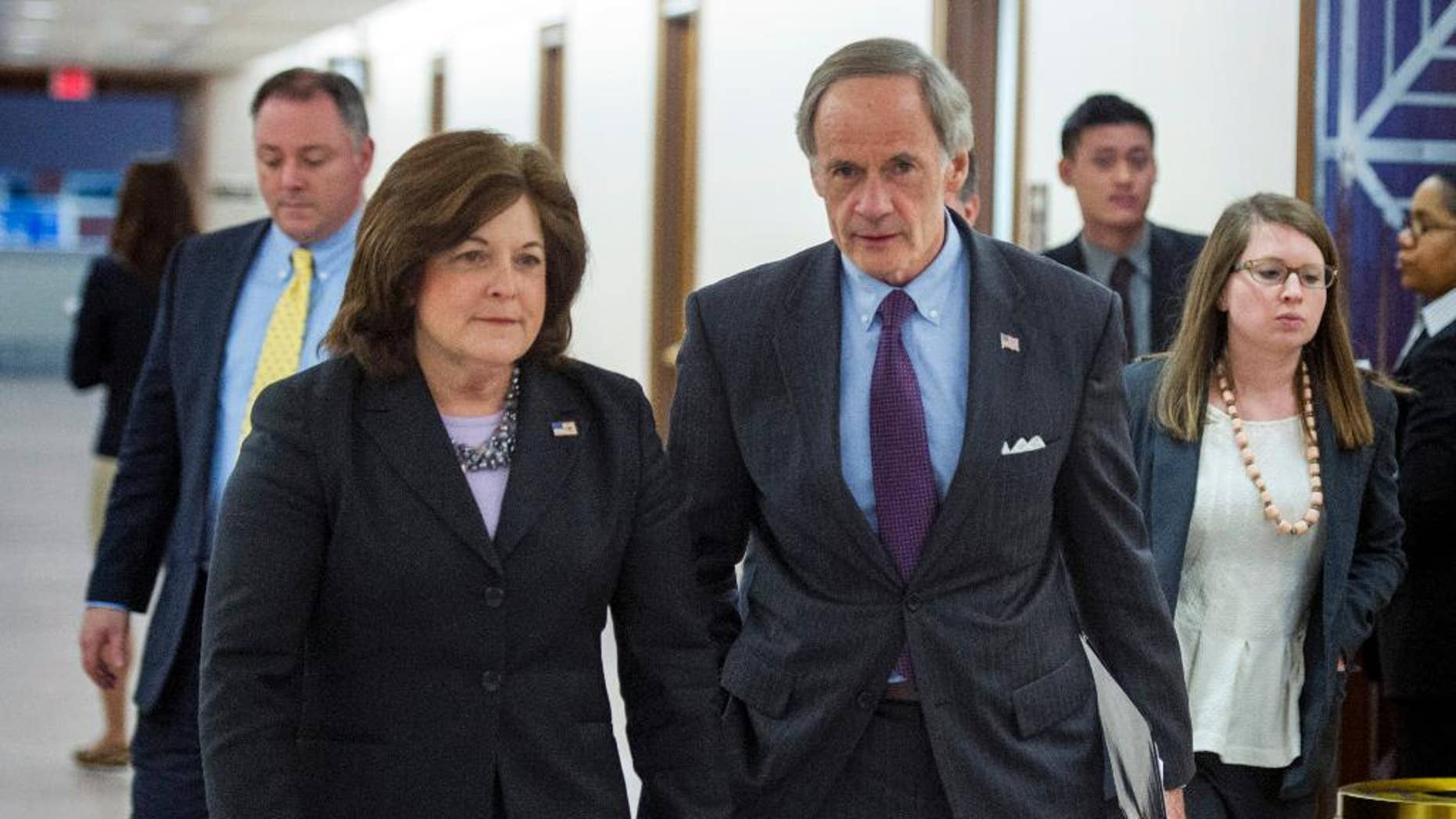 United States Secret Service director Julia Pierson and Senate Homeland Security Committee Chairman Tom Carper, D-Del., leave a committee hearing on recent Secret Service agents behavior, on Capitol Hill in Washington, Tuesday, April 1, 2014. (AP Photo/Cliff Owen)