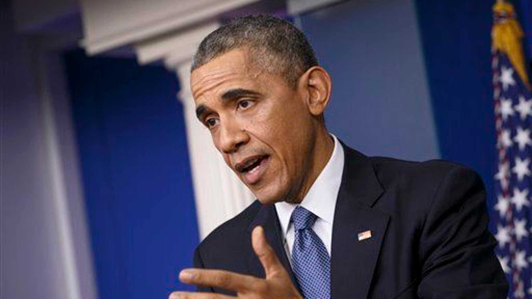 """President Barack Obama speaks during a news conference in the Brady Press Briefing Room of the White House in Washington, Friday, Dec. 19, 2014. When the leaders of the U.S. and Cuba had their first phone conversation in more than 50 years, they were not at a loss for words. As President Barack Obama told the story at his news conference Friday, he opened his call with Cuban President Raul Castro _ brother of famously longwinded Fidel _ with a 15-minute monologue, then apologized for taking so much time. """"He said, 'Don't worry about it, Mr. President,'"""" Obama related. """"'You're still a young man, and you have still the chance to break Fidel's record. He once spoke seven hours straight."""" (AP Photo/J. Scott Applewhite)"""
