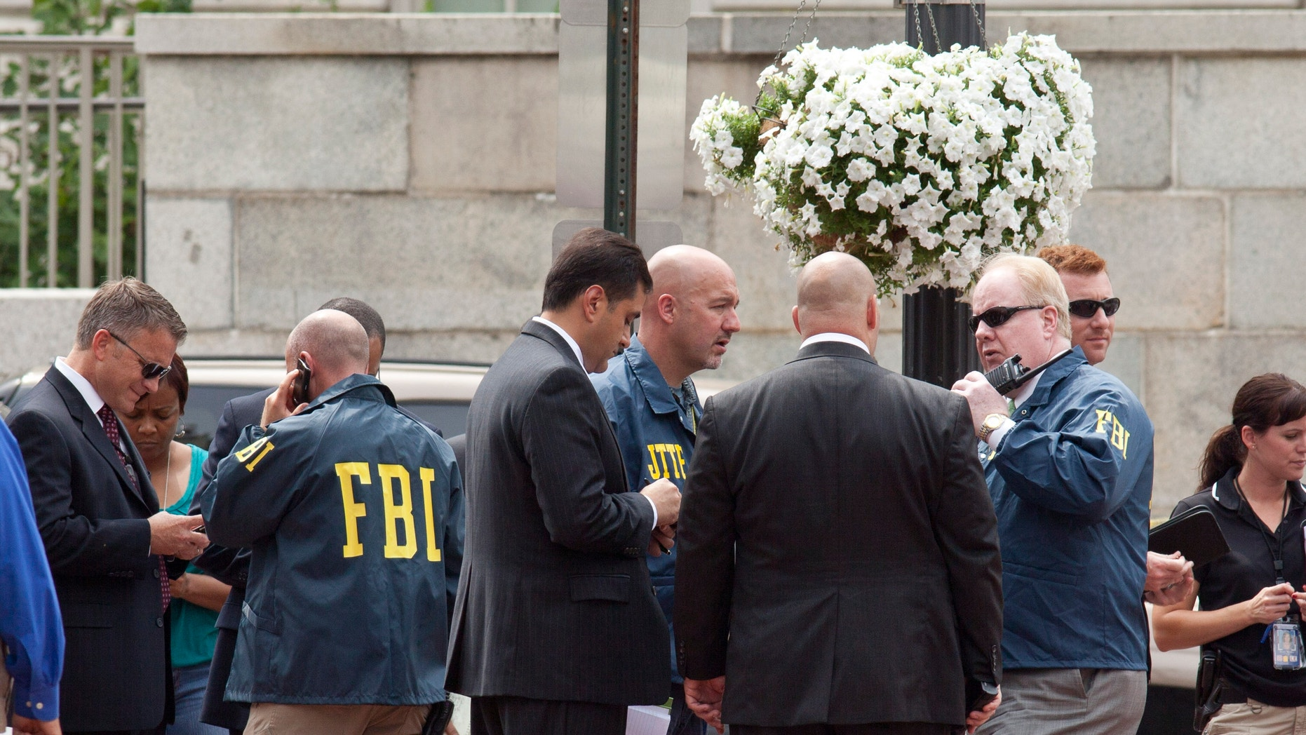 Aug. 15, 2012: Washington Police and FBI agents gather outside the Family Research Council in Washington.