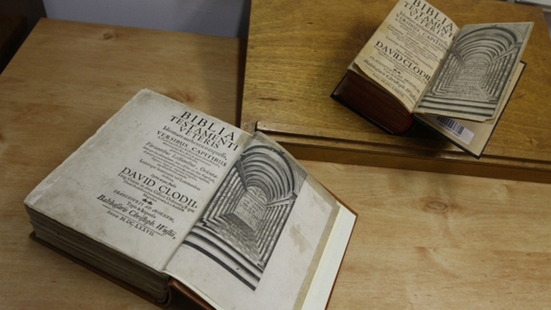 The twin Tanachim (the plural of Tanakh) are shown side by side, with the newfound copy on the bottom. As with all Hebrew books, they open from right to left.