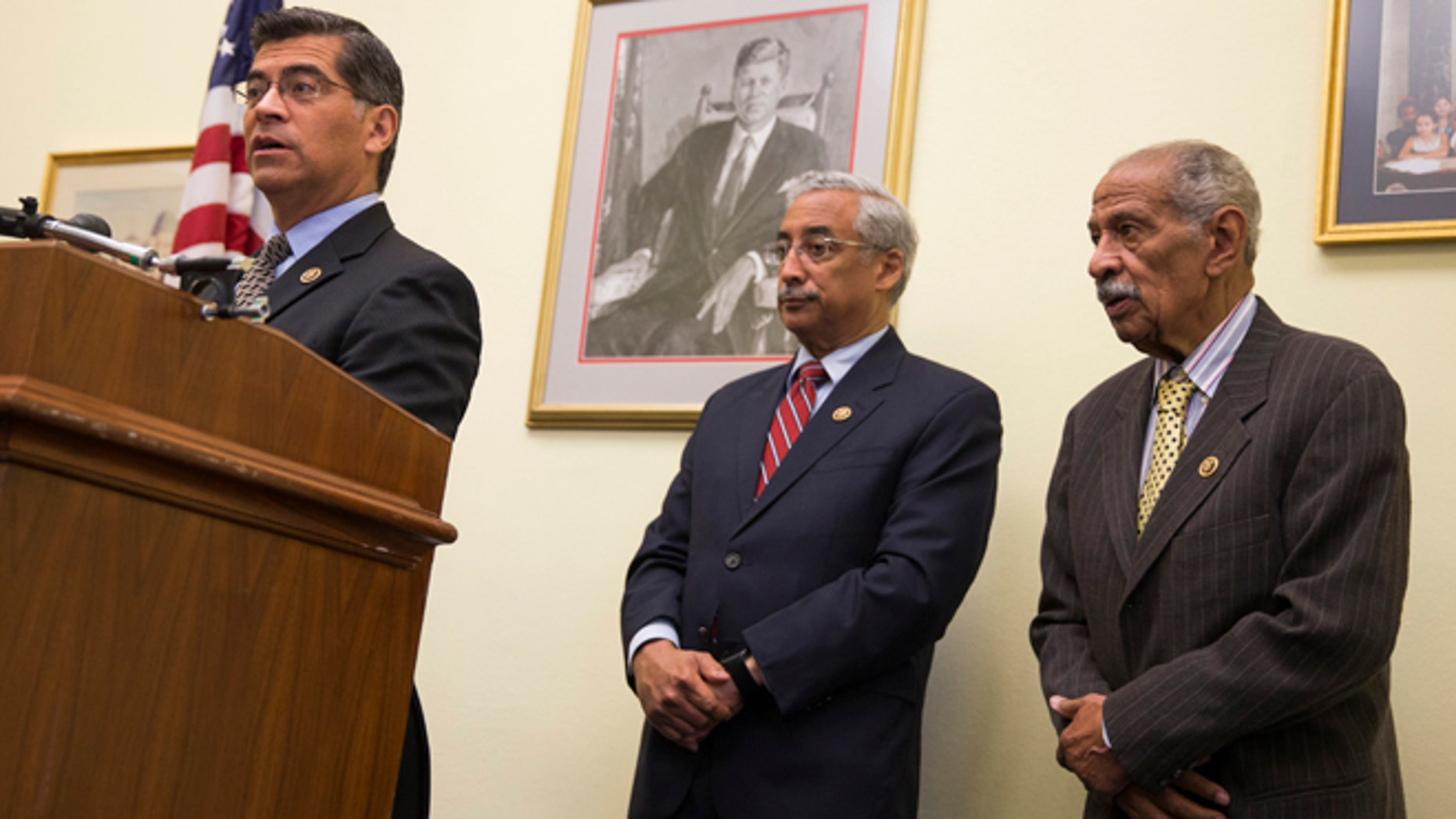 Rep. Xavier Becerra, D-Calif., left, accompanied by Rep. Bobby Scott, D-Va., ranking member on the House Education and the Workforce Committee, center, and Rep. John Conyers, D-Mich., speaks during a news conference on Capitol Hill in Washington, Tuesday, May 17, 2016. Six decades after the Supreme Court outlawed separating students by race, stubborn disparities persist in how the country educates its poor and minority children. A report Tuesday, May 17, 2016, by the nonpartisan Government Accountability Office found deepening segregation of black and Hispanic students nationwide, with a large increase among K-12 public schools.  (AP Photo/Evan Vucci)