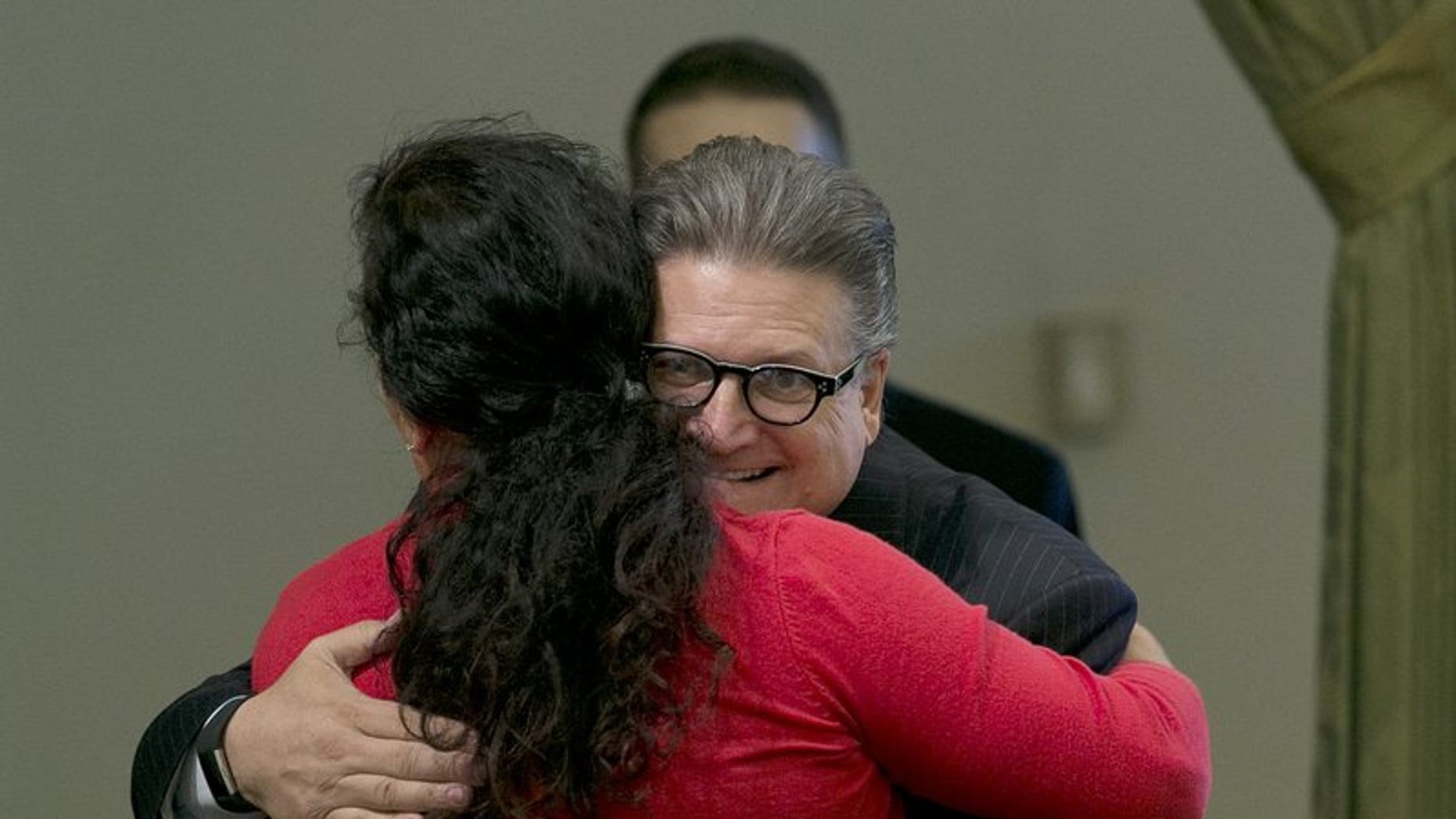 California state Sen. Bob Hertzberg hugs Assemblywoman Lorena Gonzalez Fletcher, D-San Diego, after his storm water bill was approved by the Assembly in Sacramento, Calif., Aug. 31, 2017.